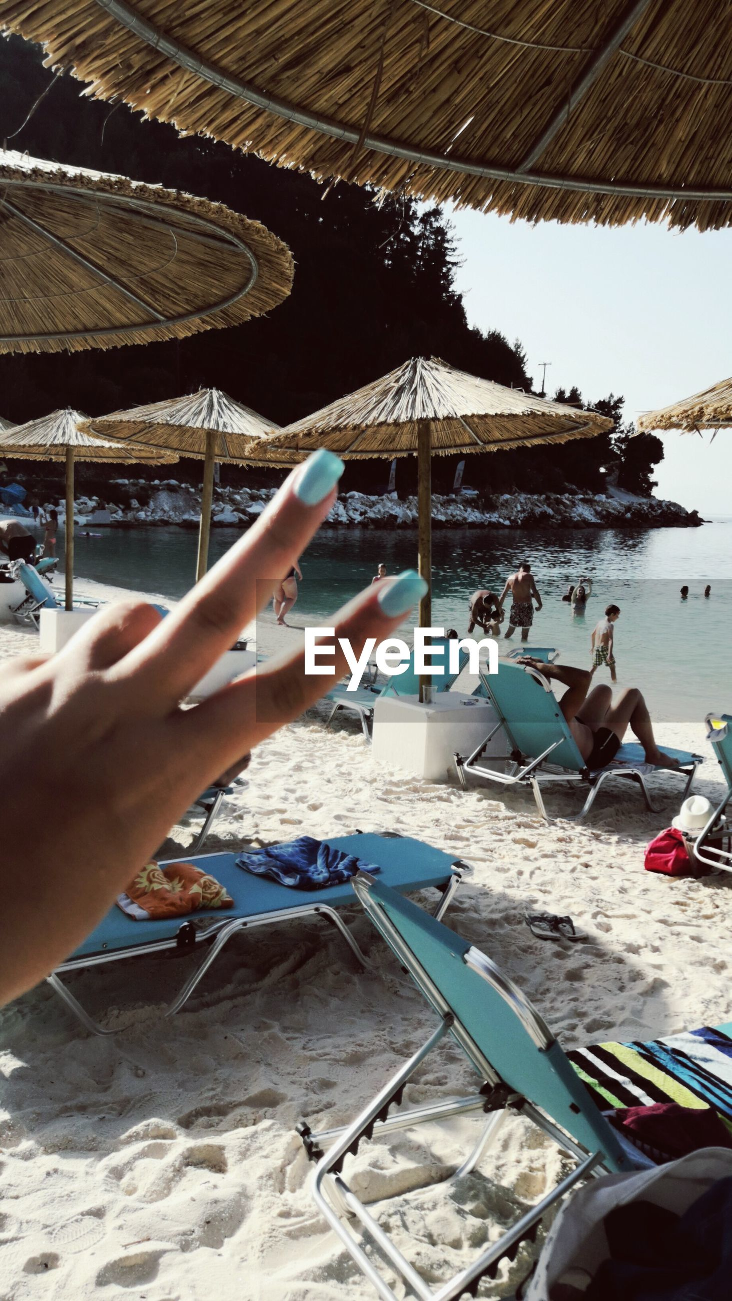 beach, human hand, real people, sand, one person, holding, day, human body part, sea, outdoors, lifestyles, nature, men, close-up, sky, people