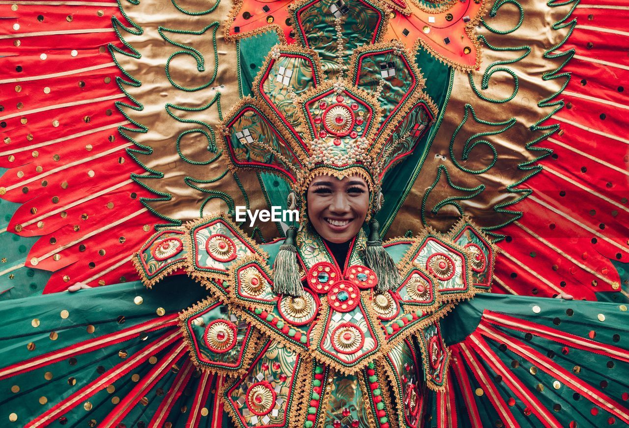 Portrait Of Smiling Mid Adult Woman Wearing Costume During Traditional Festival