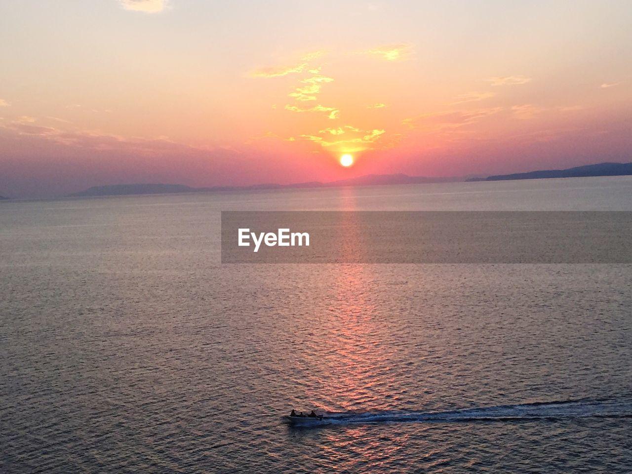 sunset, sky, scenics - nature, water, beauty in nature, tranquility, tranquil scene, orange color, sea, sun, cloud - sky, idyllic, waterfront, nautical vessel, nature, no people, non-urban scene, sunlight, horizon, horizon over water, outdoors