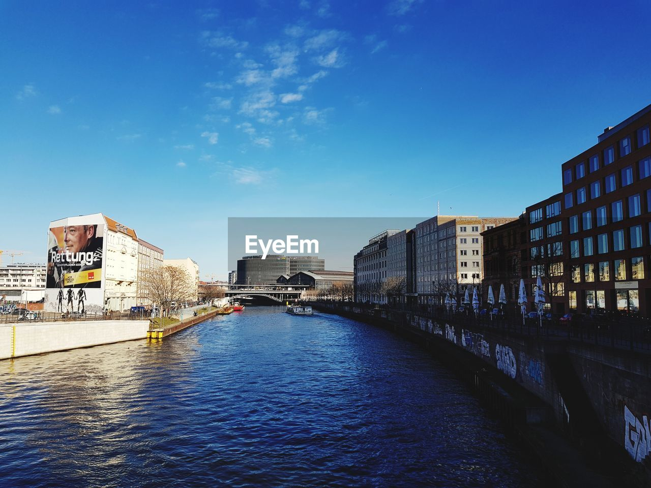 architecture, built structure, building exterior, water, sky, waterfront, city, building, river, nature, blue, bridge, day, connection, no people, outdoors, residential district, bridge - man made structure, cityscape