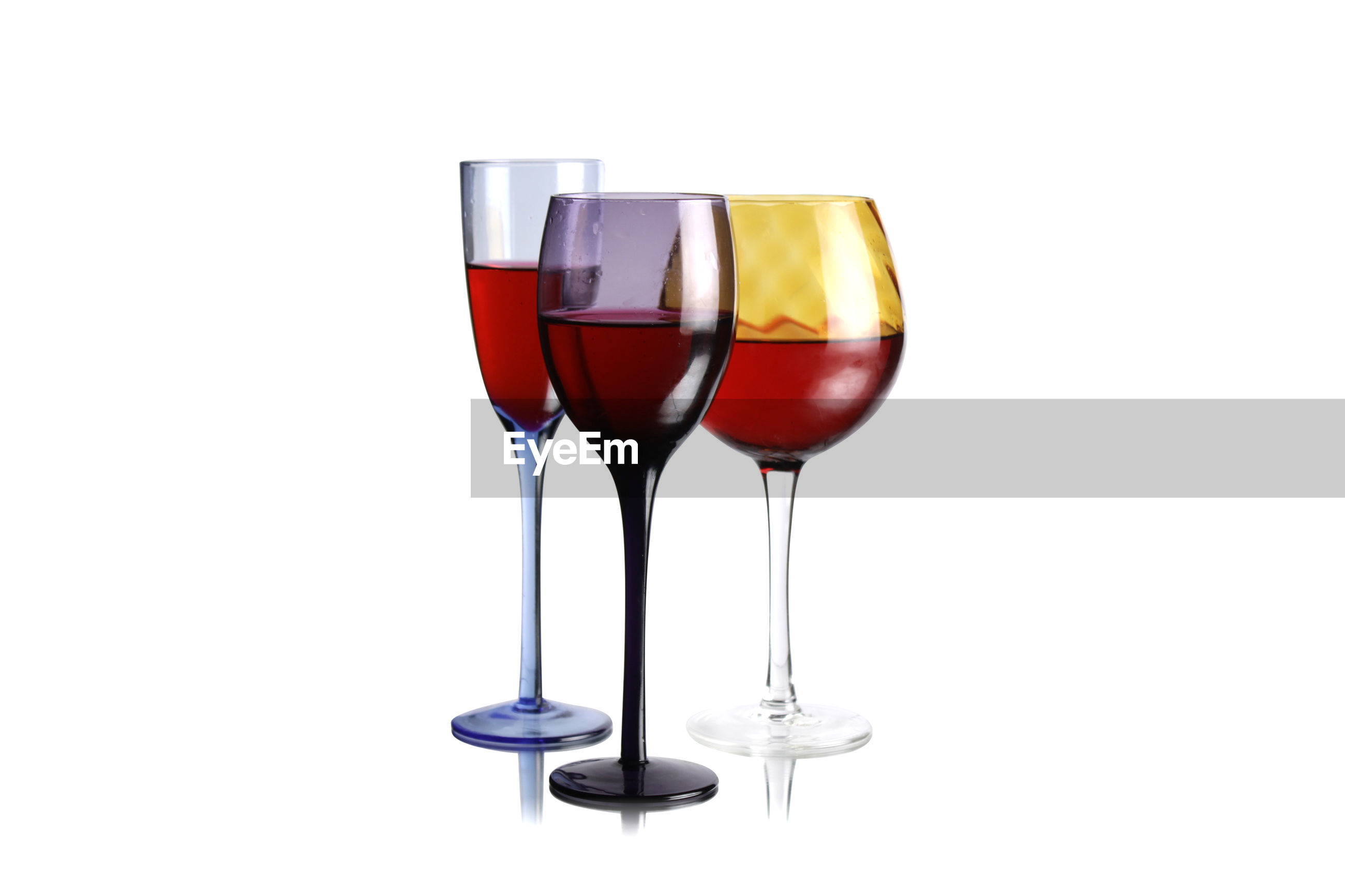 Close-up of wineglasses on white background