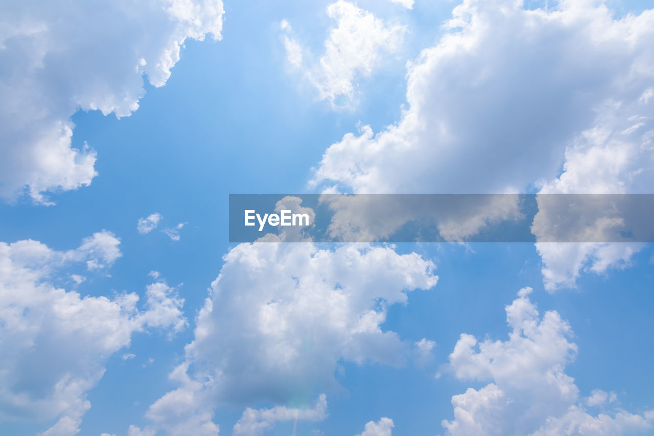 cloud - sky, sky, beauty in nature, low angle view, tranquility, scenics - nature, nature, no people, day, blue, outdoors, white color, backgrounds, idyllic, tranquil scene, sunlight, cloudscape, full frame, non-urban scene, meteorology