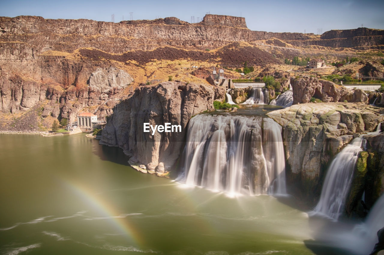 water, scenics - nature, beauty in nature, travel destinations, rock, rock formation, rock - object, travel, tourism, waterfall, nature, solid, long exposure, mountain, no people, day, environment, non-urban scene, cliff, flowing water, outdoors, formation, power in nature, flowing
