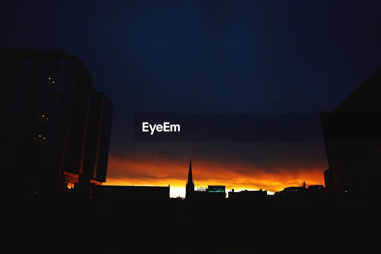 architecture, built structure, building exterior, silhouette, sunset, city, no people, skyscraper, modern, sky, outdoors, cityscape