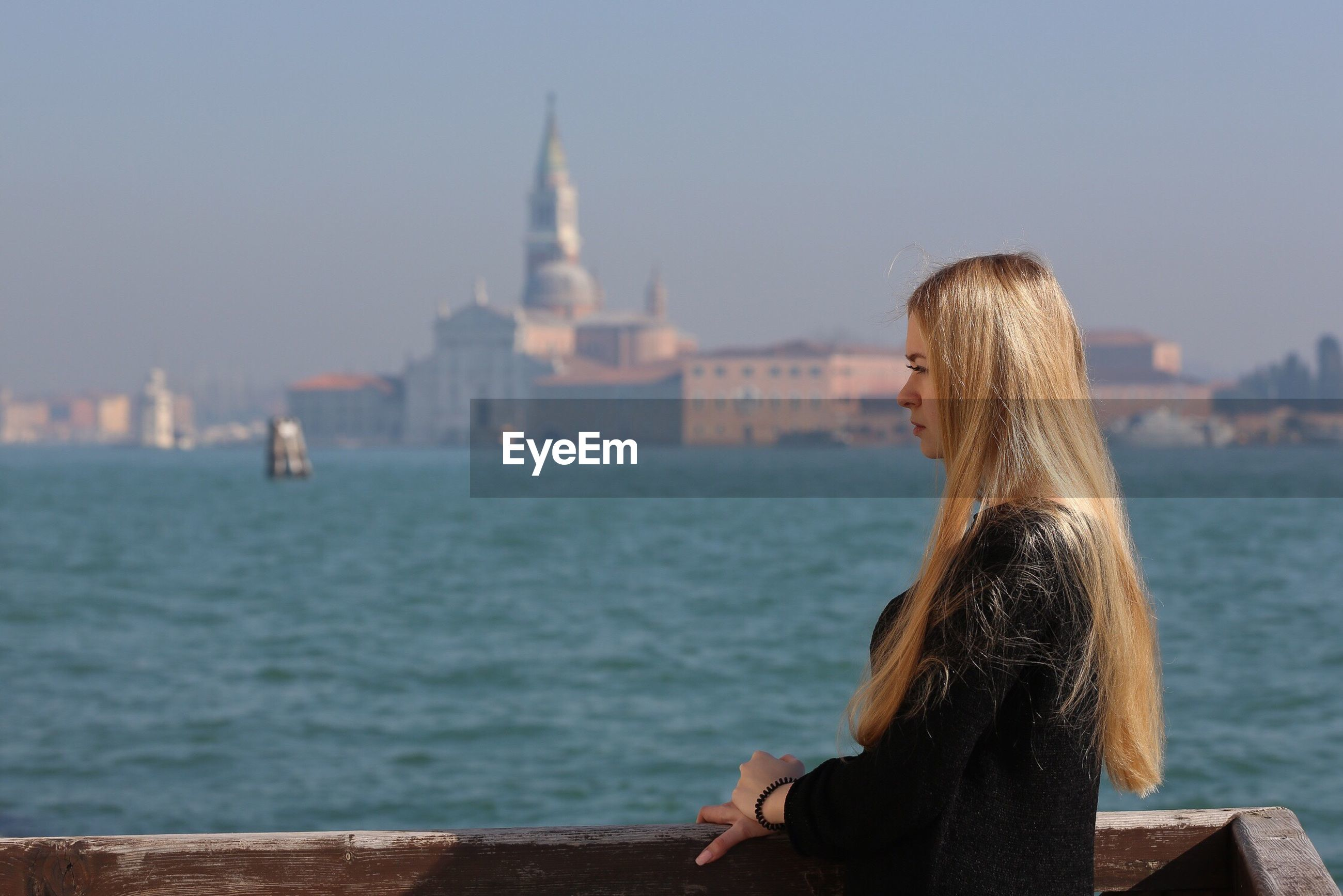 Side view of young woman by venice seaside