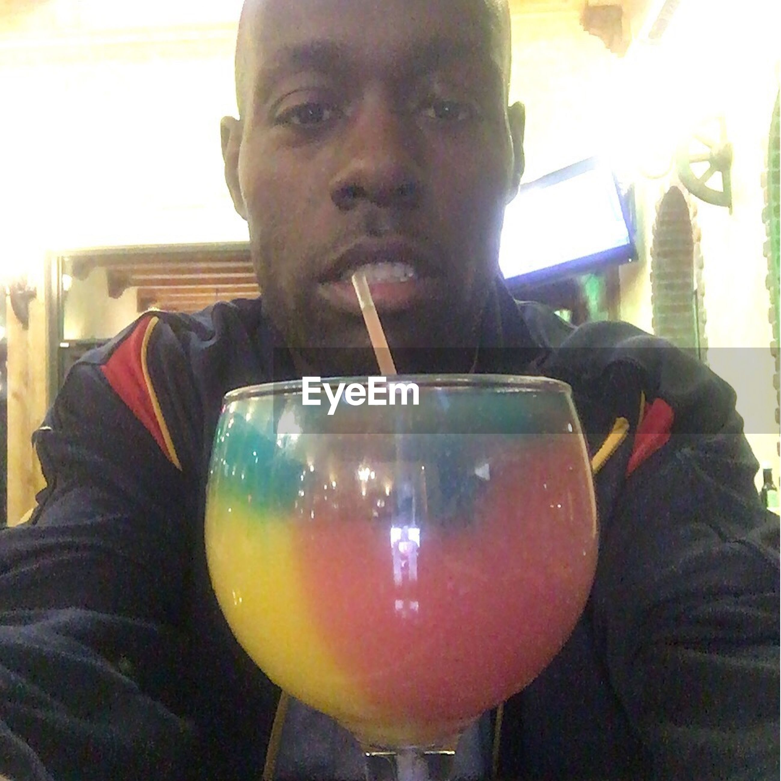 food and drink, indoors, drink, lifestyles, refreshment, leisure activity, holding, drinking glass, close-up, alcohol, person, headshot, freshness, young men, front view, food, restaurant, casual clothing