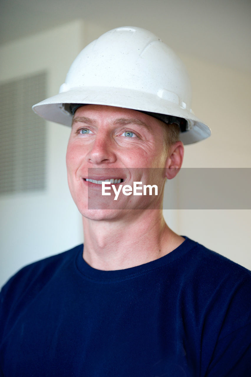 Portrait Of Young Man In Hard Hat