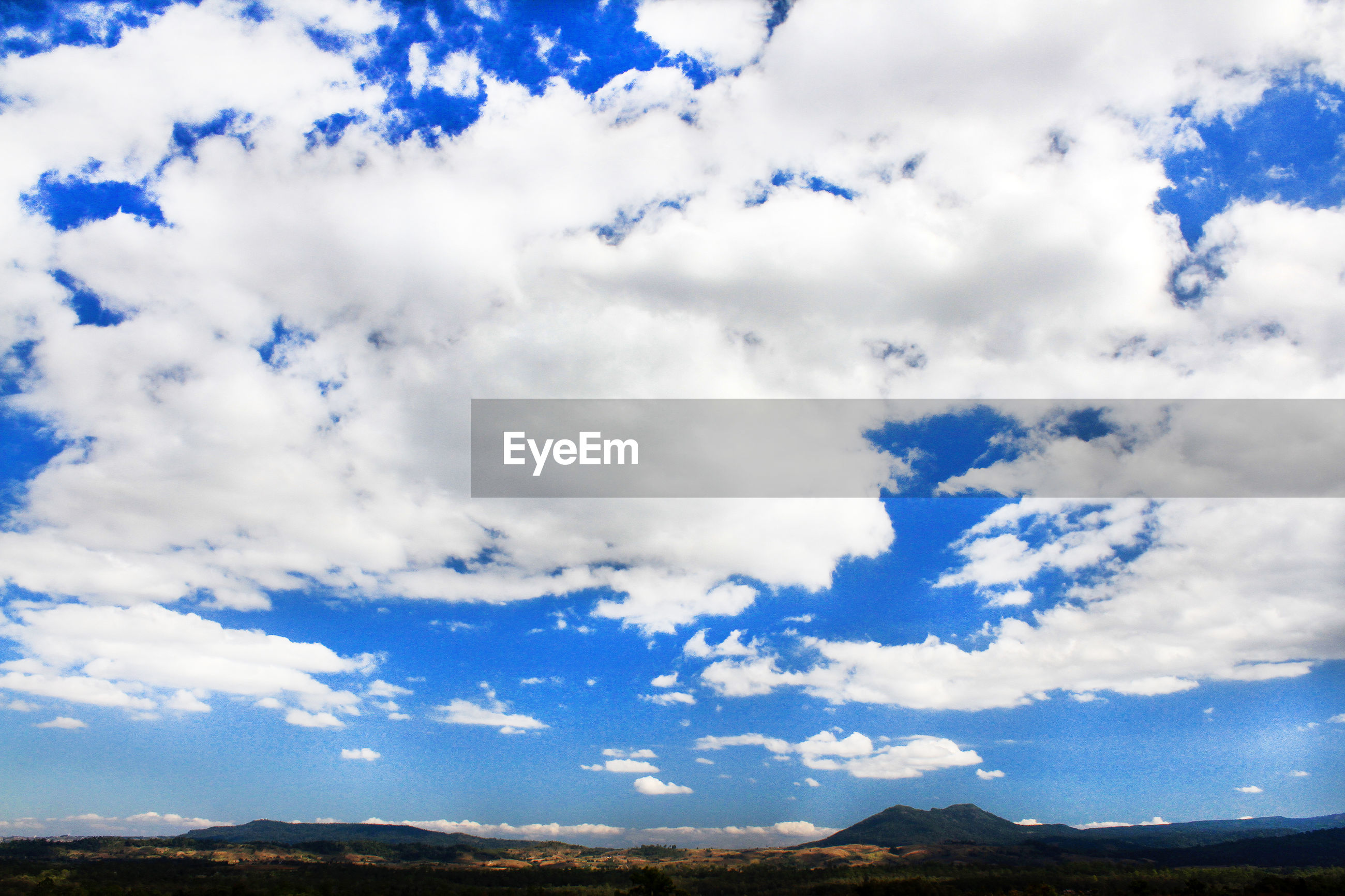 LOW ANGLE VIEW OF CLOUDS OVER LAND