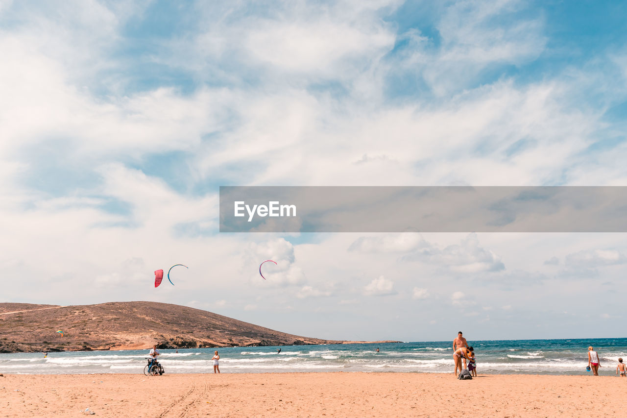 sky, sea, water, beach, land, cloud - sky, group of people, horizon, horizon over water, real people, beauty in nature, nature, scenics - nature, incidental people, day, leisure activity, sand, lifestyles, vacations, outdoors