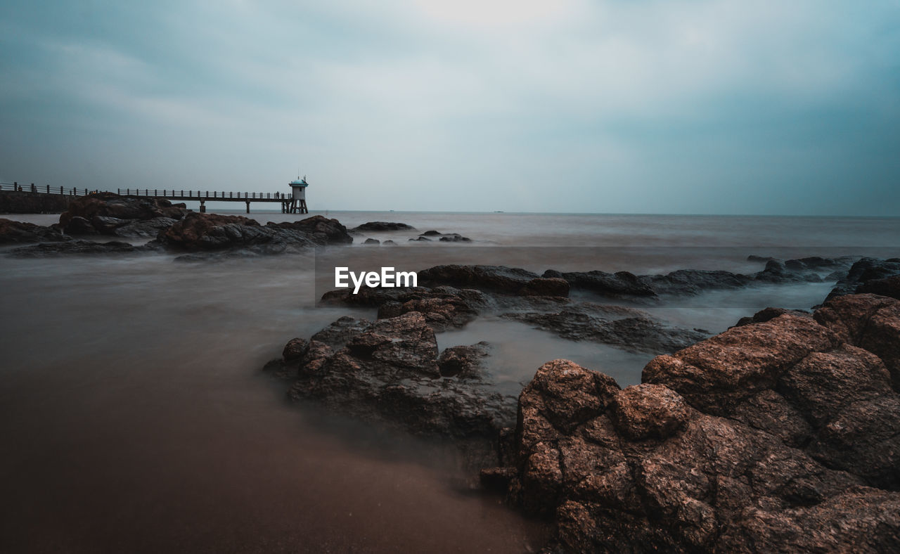 sky, water, sea, horizon over water, cloud - sky, horizon, scenics - nature, rock, rock - object, beauty in nature, solid, beach, nature, tranquil scene, land, tranquility, long exposure, motion, no people, outdoors, power in nature
