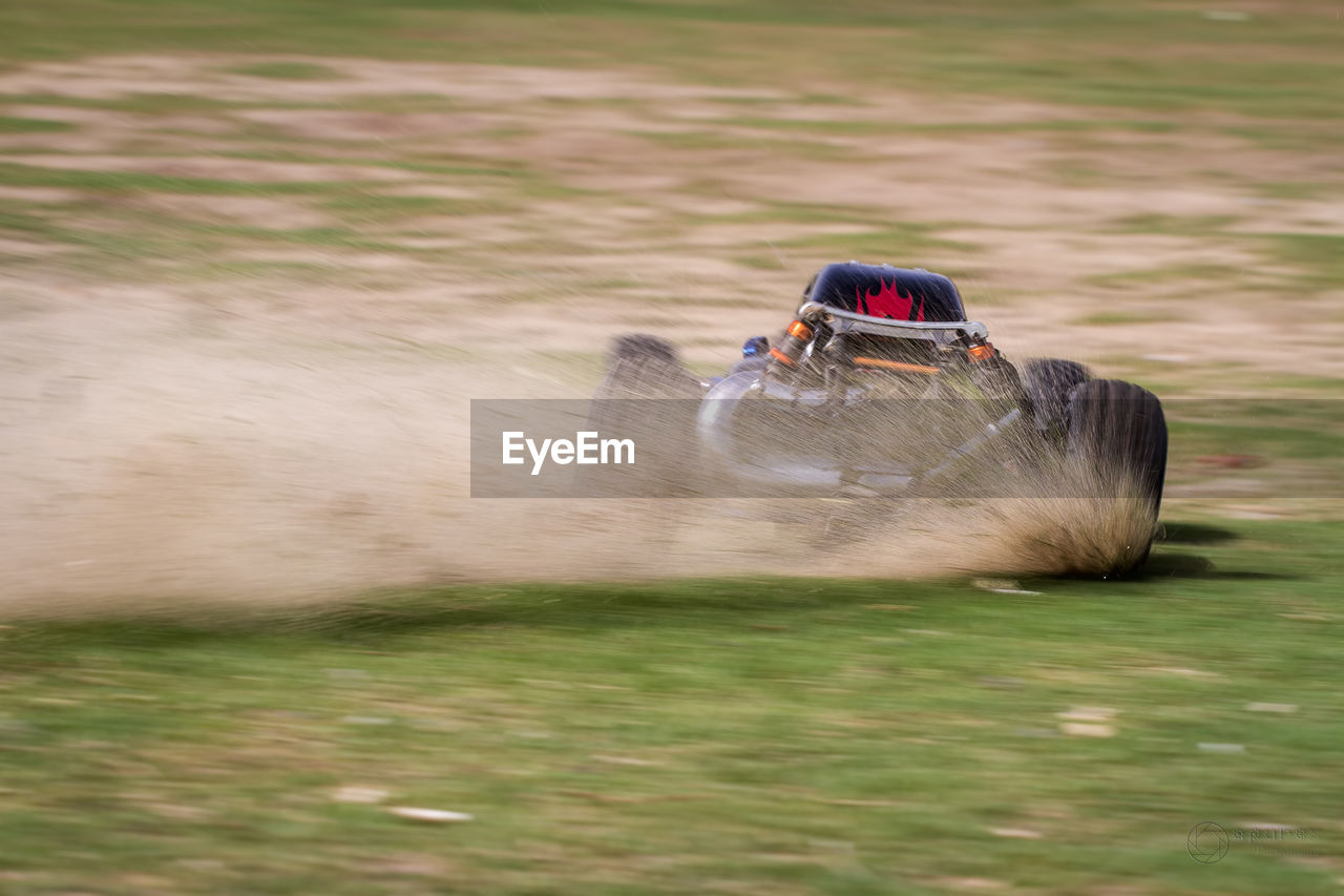speed, motion, grass, outdoors, nature, blurred motion, field, day, one person, leisure activity, transportation, real people, mammal, domestic animals, adventure, men, water, jet boat, people