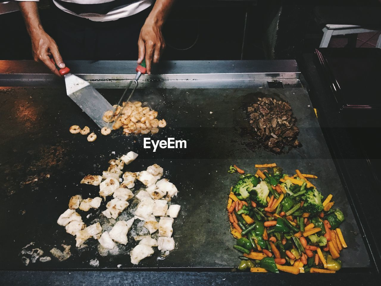 Midsection Of Chef Preparing Food In Kitchen