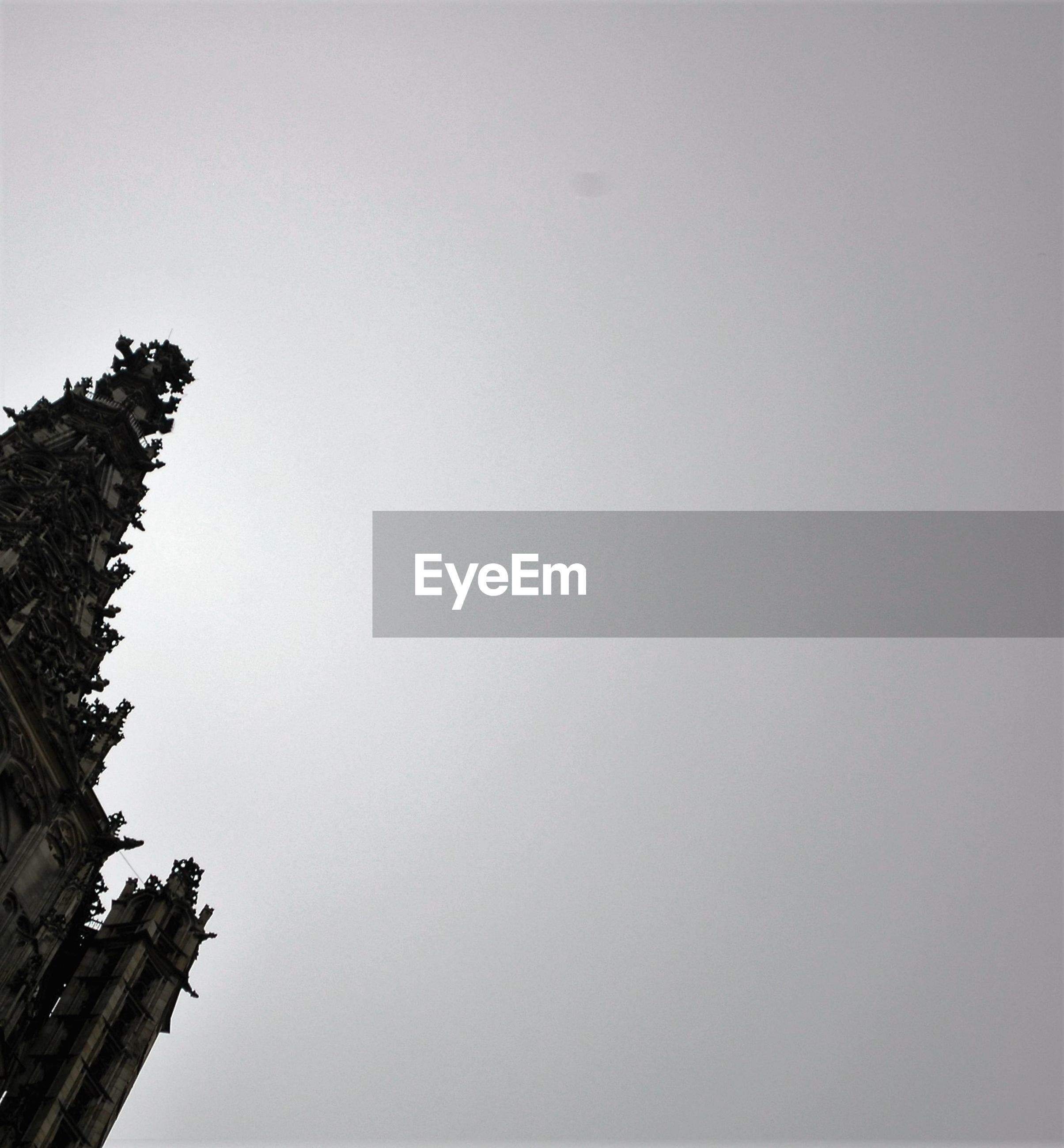 LOW ANGLE VIEW OF BUILT STRUCTURES AGAINST CLEAR SKY