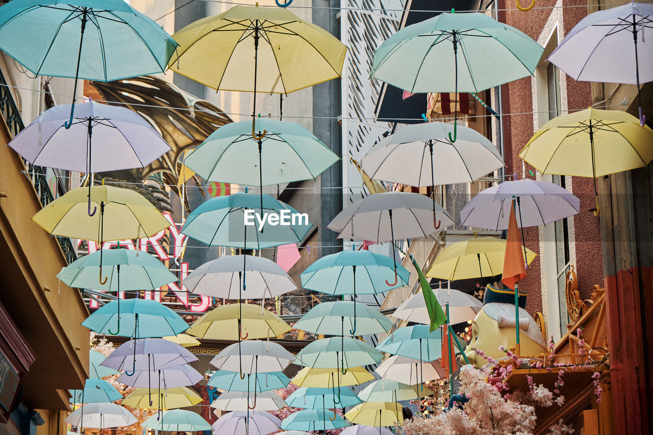 protection, umbrella, security, multi colored, parasol, architecture, outdoors, sunlight, no people, dome, group, large group of objects, nature, choice, safety, in a row, built structure, city