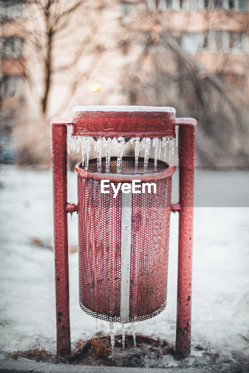 winter, cold temperature, focus on foreground, snow, nature, day, tree, red, no people, land, outdoors, field, frozen, bare tree, plant, metal, built structure, wood - material, absence