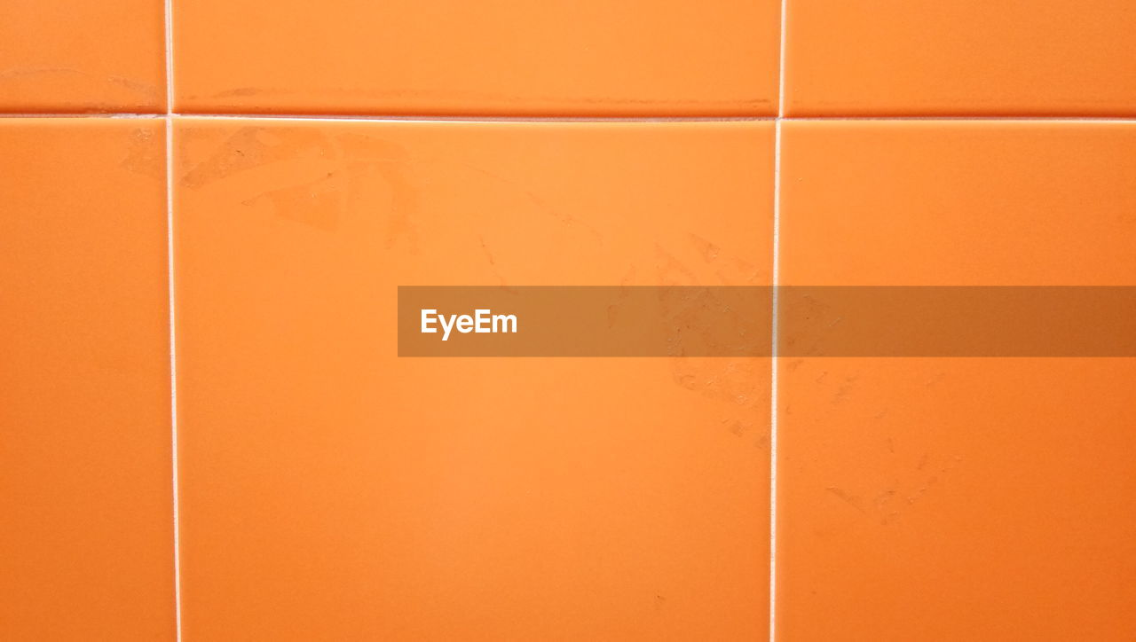 full frame, wall - building feature, orange color, backgrounds, no people, built structure, close-up, architecture, indoors, pattern, textured, copy space, shadow, white color, day, wall, brown, tile, sunlight, orange