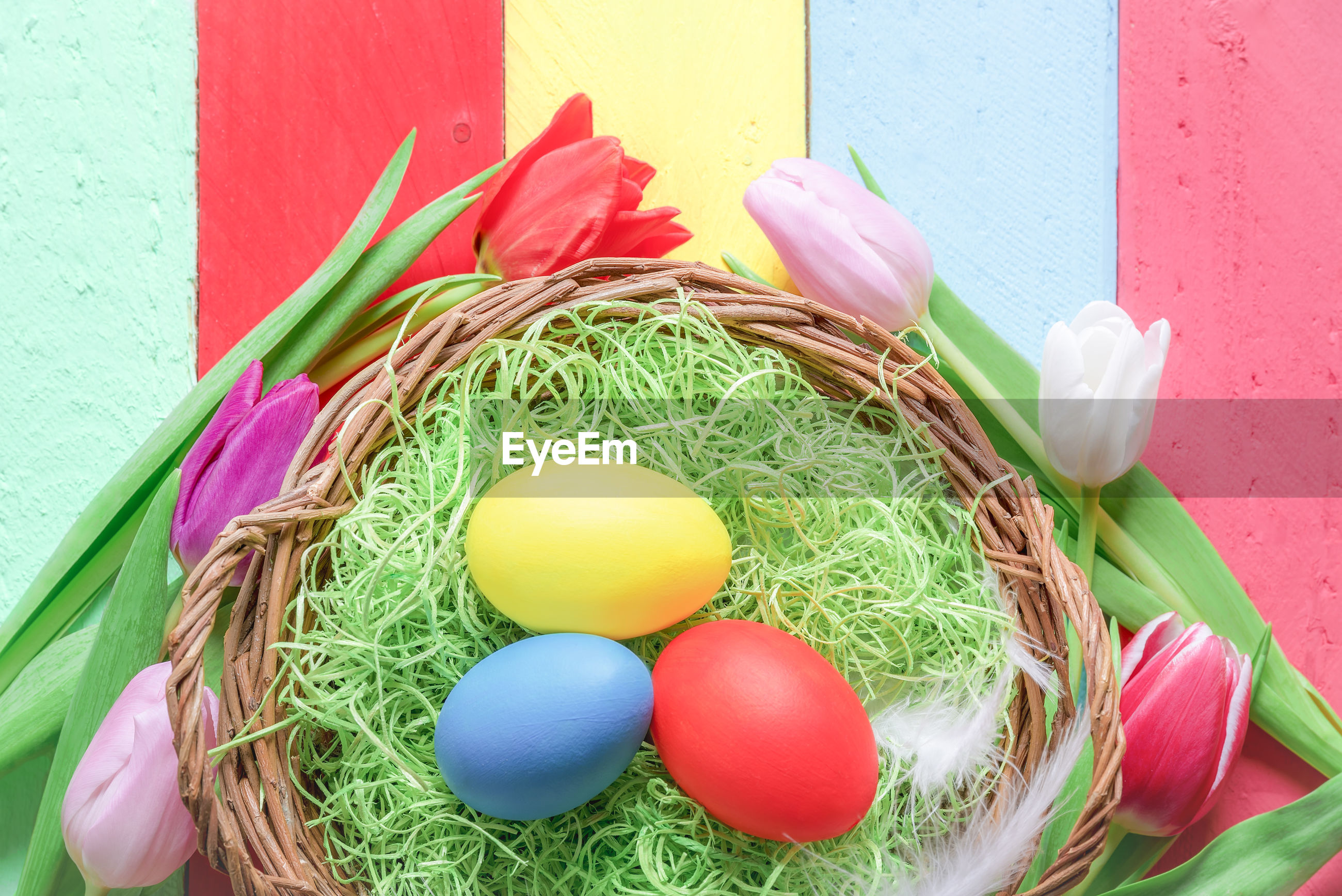 Close-up of easter eggs on colorful table