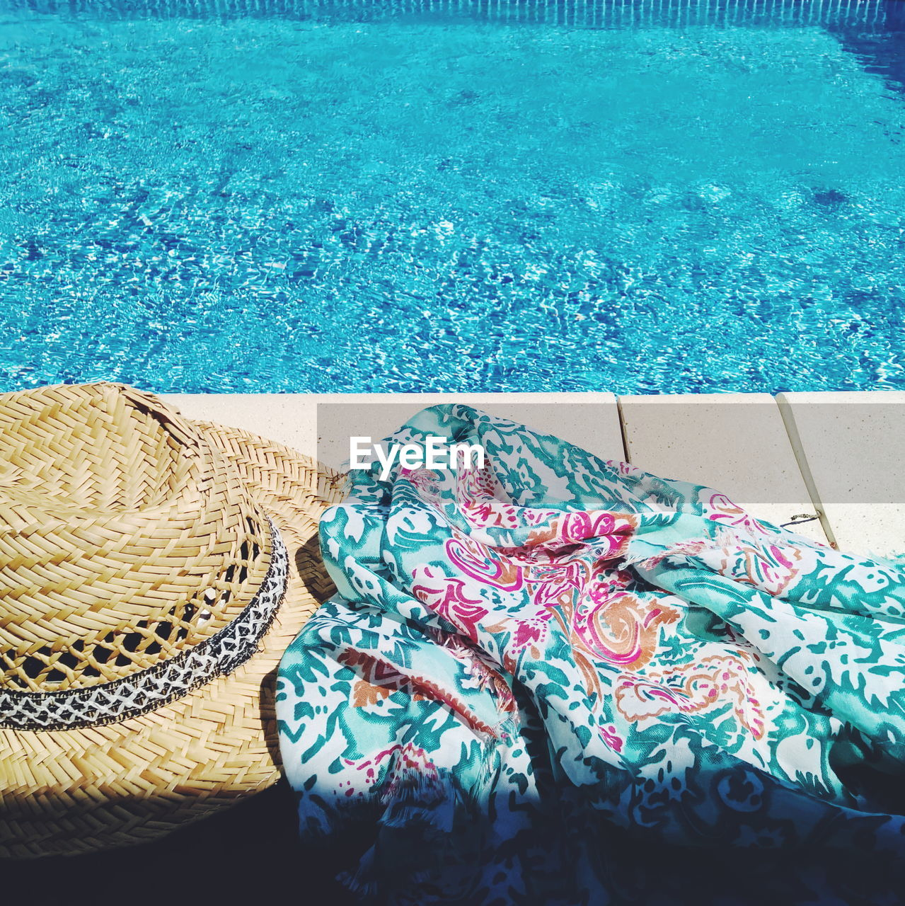Close-Up Of Sunhat And Scarf By Poolside