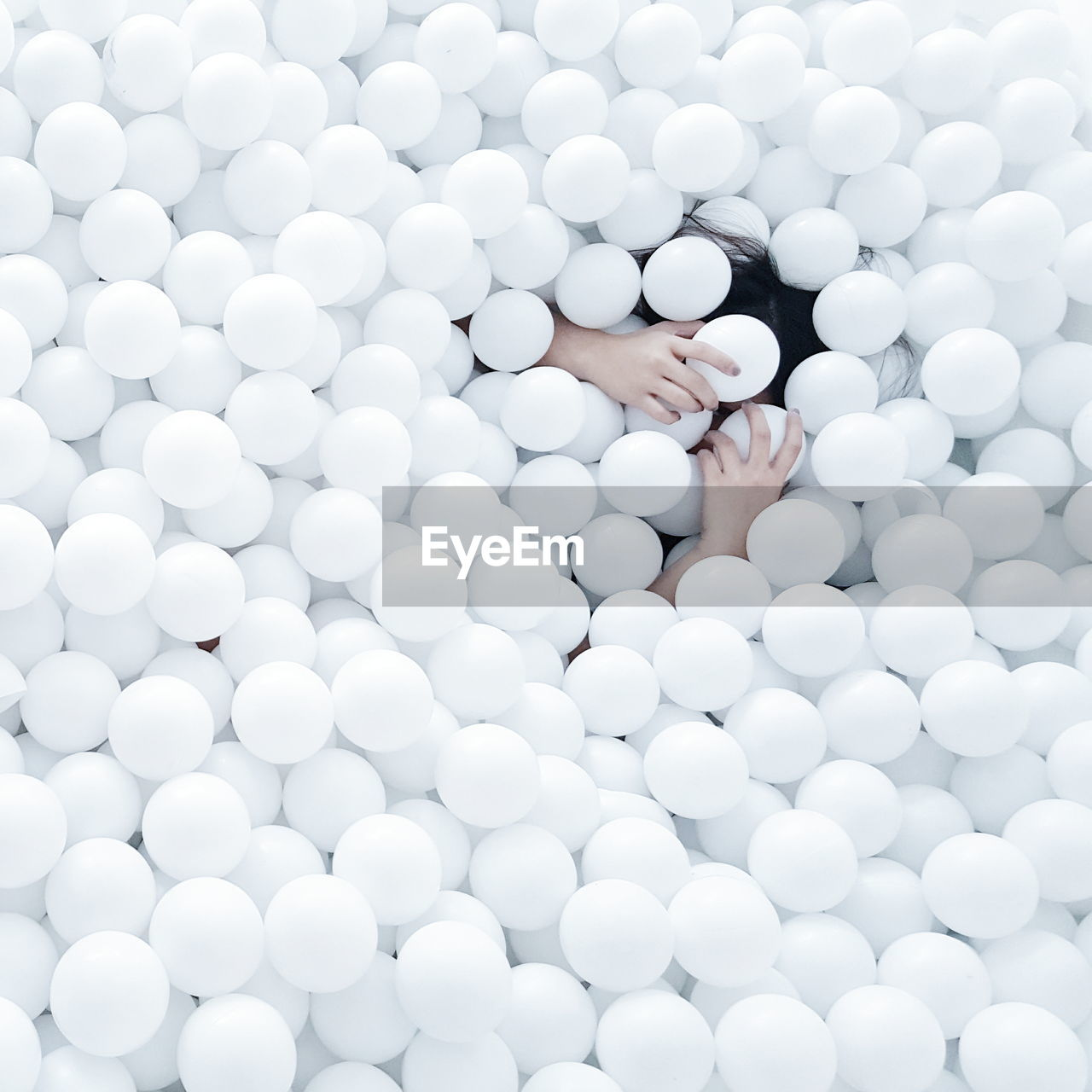 High Angle View Of Woman Enjoying In White Ball Pool