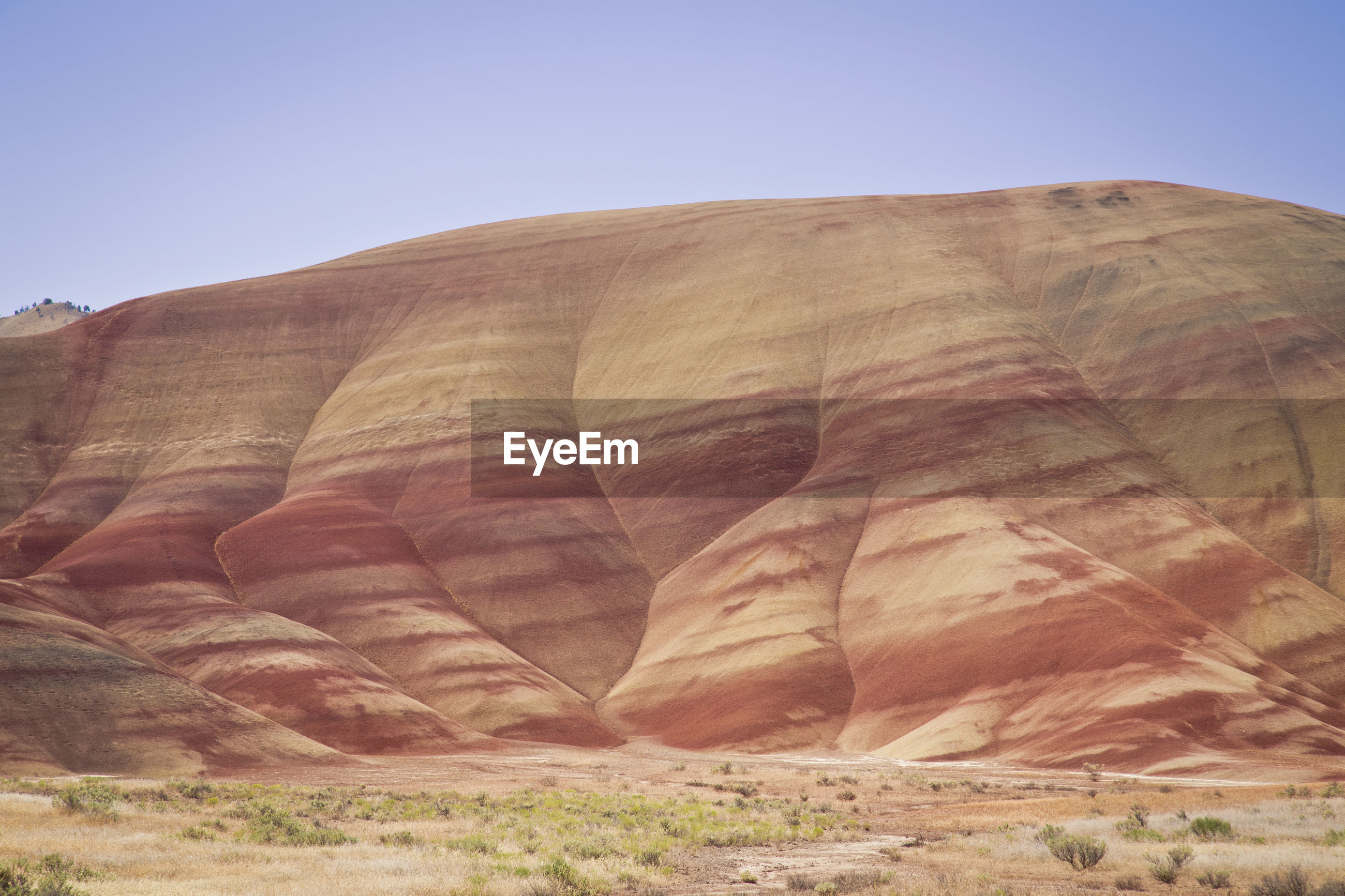 Scenic view of painted hills against clear sky