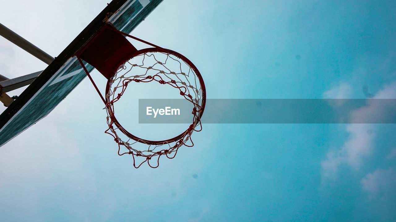 basketball - sport, sky, low angle view, basketball hoop, nature, day, net - sports equipment, sport, no people, cloud - sky, blue, outdoors, circle, geometric shape, shape, close-up, directly below, glass - material, metal, design