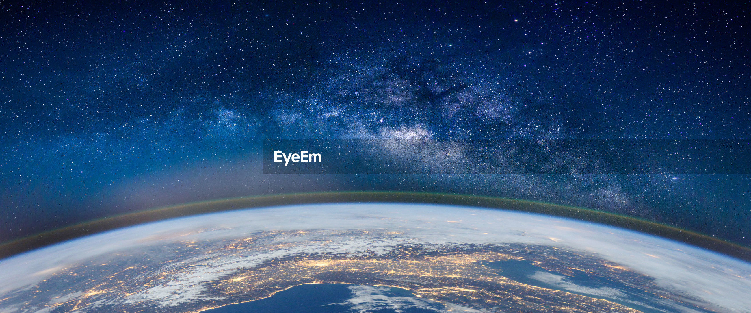 Fish-eye lens view of earth against star field