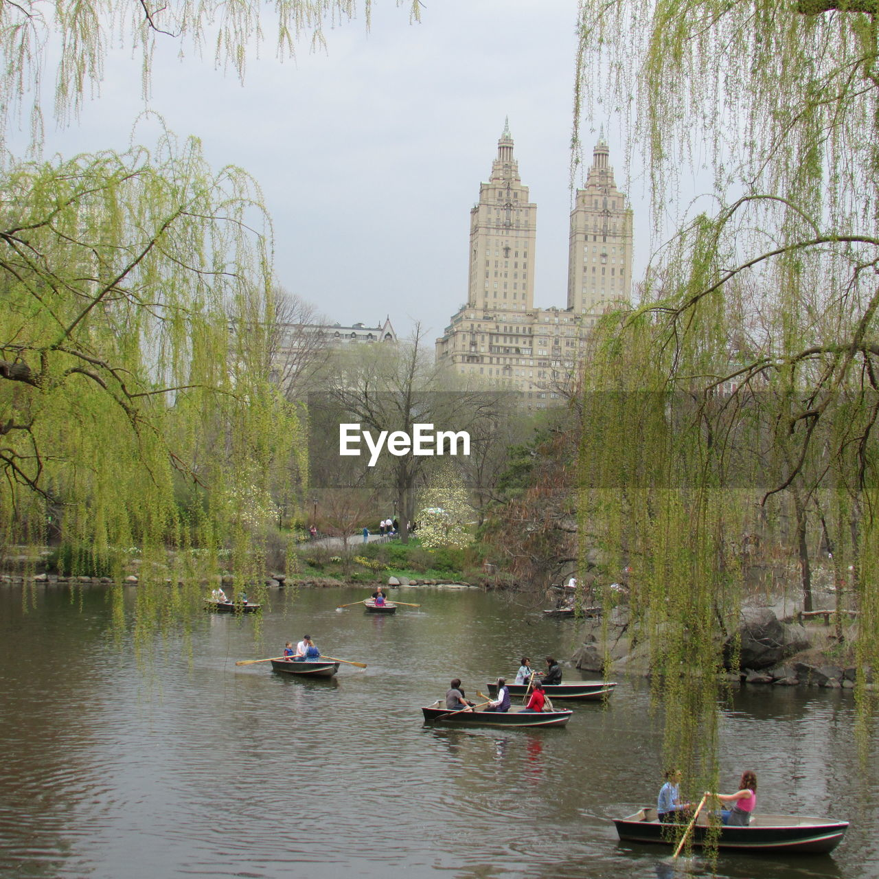 People In Boat On Lake At Central Park