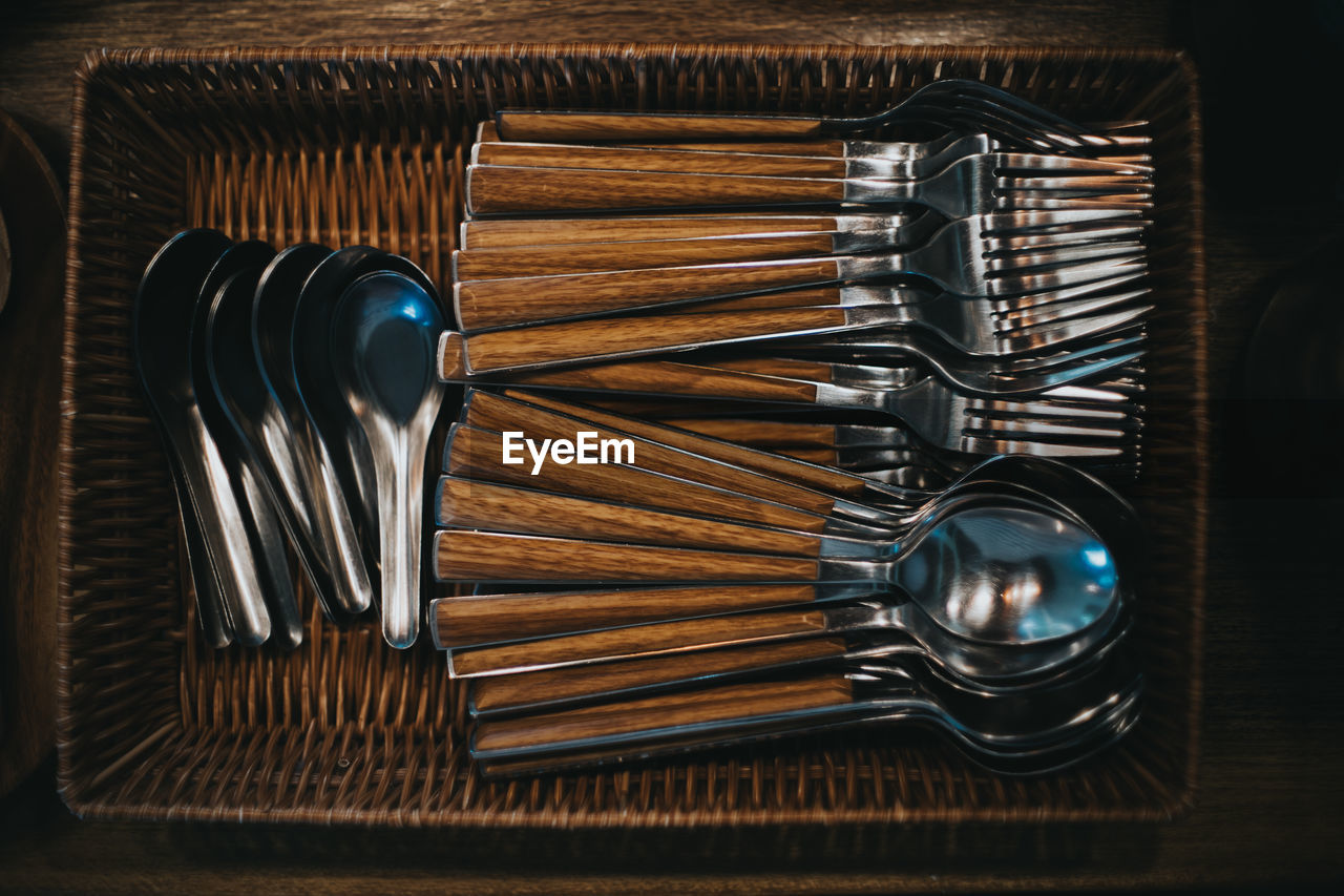Directly above shot of spoons in basket