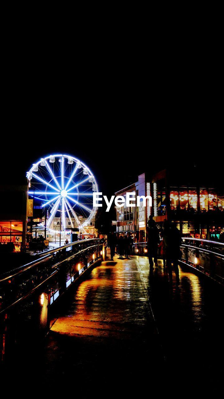 illuminated, night, amusement park ride, architecture, amusement park, ferris wheel, building exterior, built structure, city, arts culture and entertainment, sky, copy space, nature, water, street, reflection, outdoors, motion, no people, nightlife