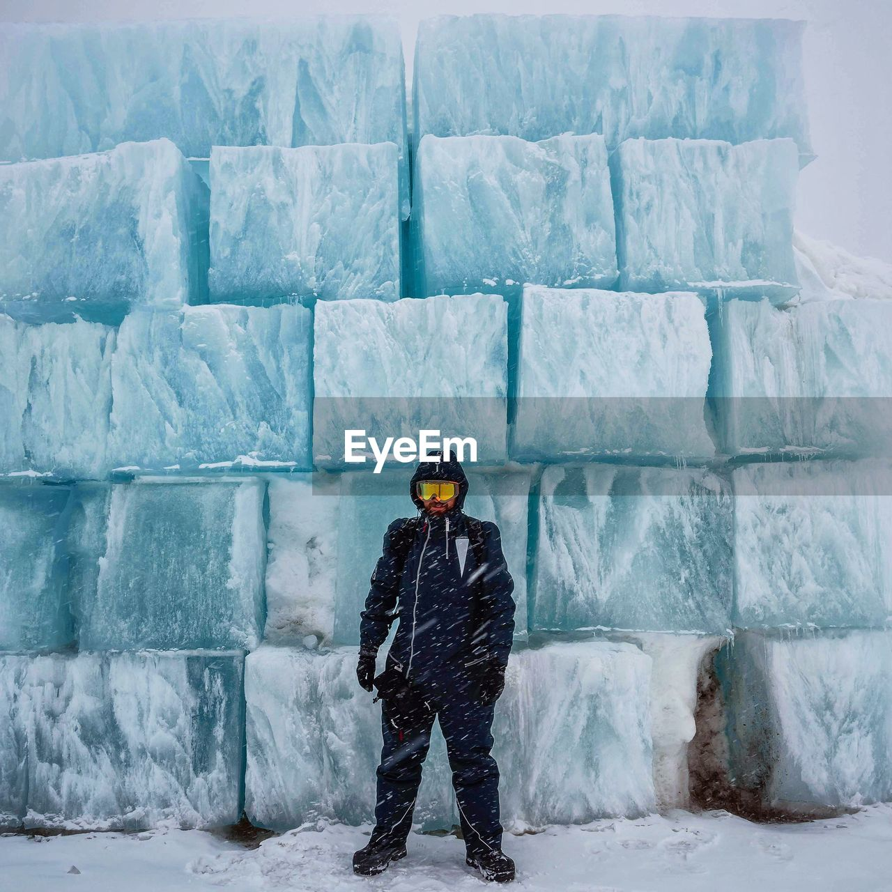 Person In Winter Clothing With Igloo In Background