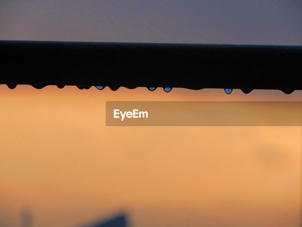 water, roof, no people, clear sky, drop, sunset, raindrop, close-up, silhouette, outdoors, sky, day, dripping, nature