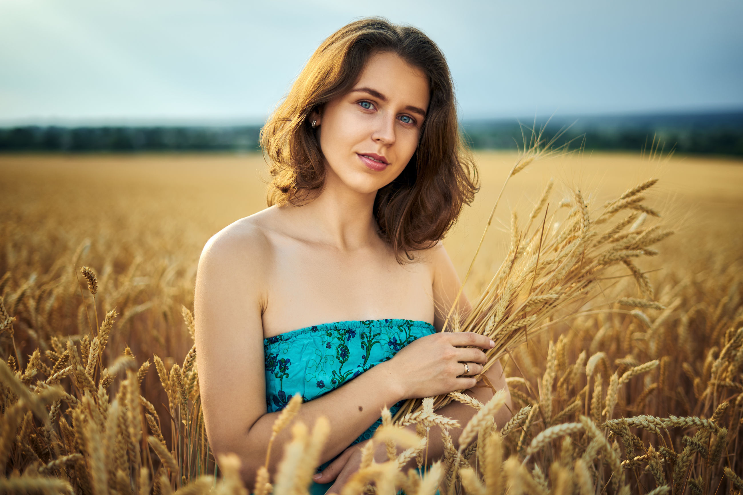 Portrait of beautiful young woman by plants in farm