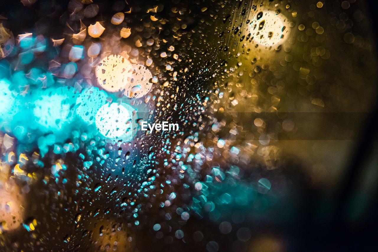 Full Frame Shot Of Wet Car Window At Night