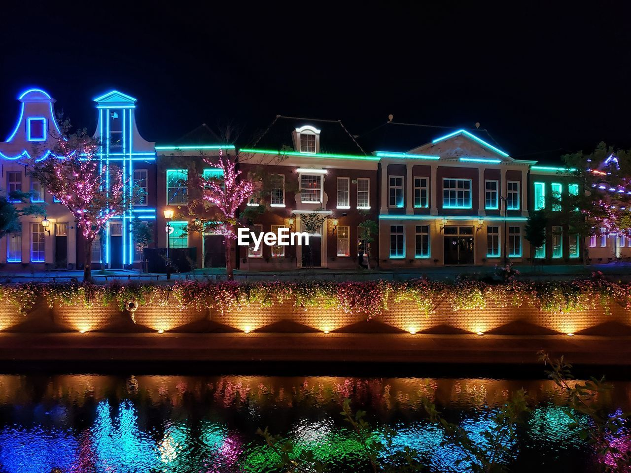night, built structure, architecture, building exterior, water, building, illuminated, reflection, waterfront, no people, nature, lighting equipment, residential district, glowing, sky, city, multi colored, house, outdoors, canal, swimming pool, luxury