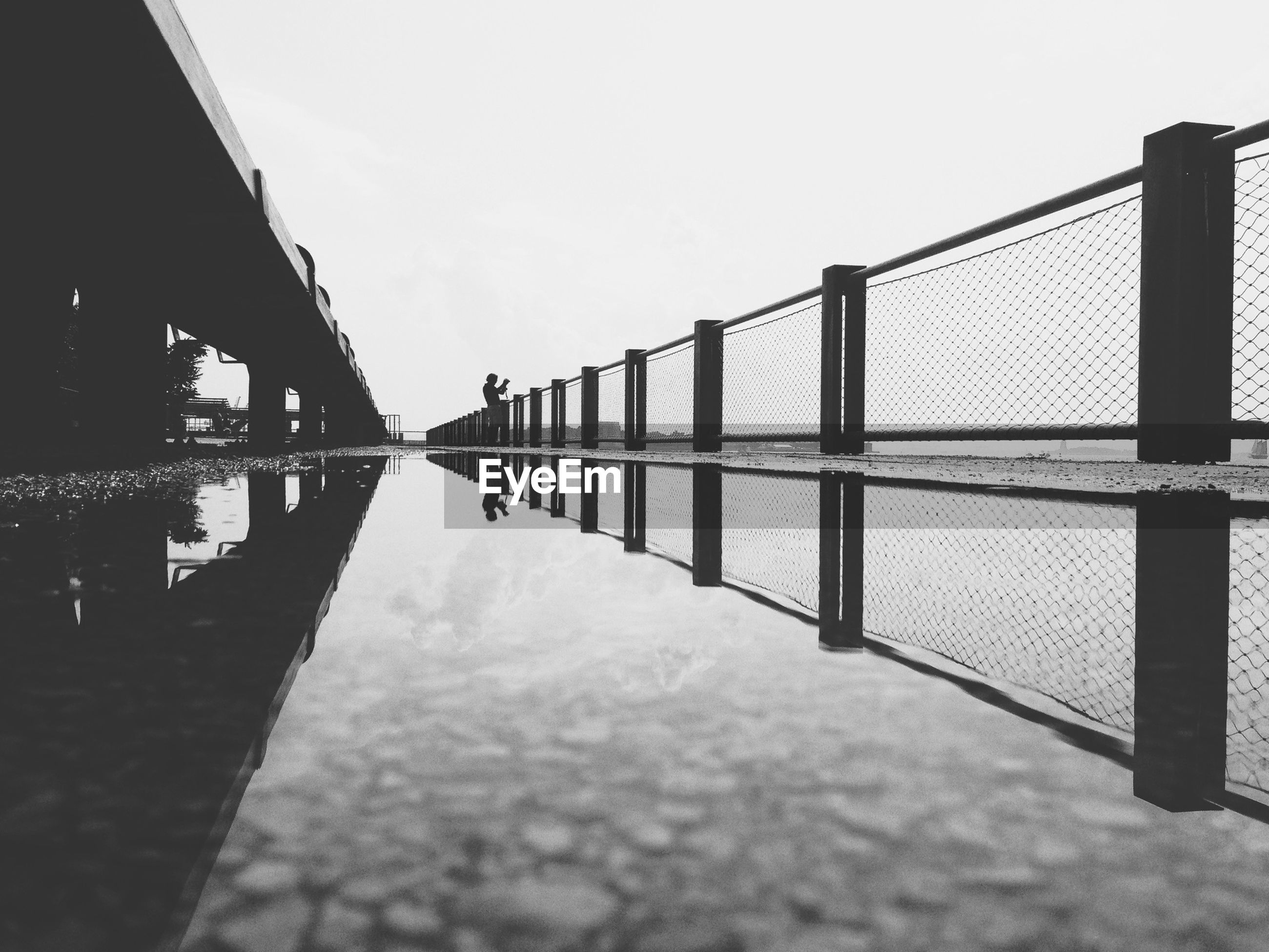 water, railing, clear sky, bridge - man made structure, connection, built structure, pier, sea, architecture, sky, the way forward, metal, fence, diminishing perspective, tranquility, protection, nature, footbridge, bridge, tranquil scene