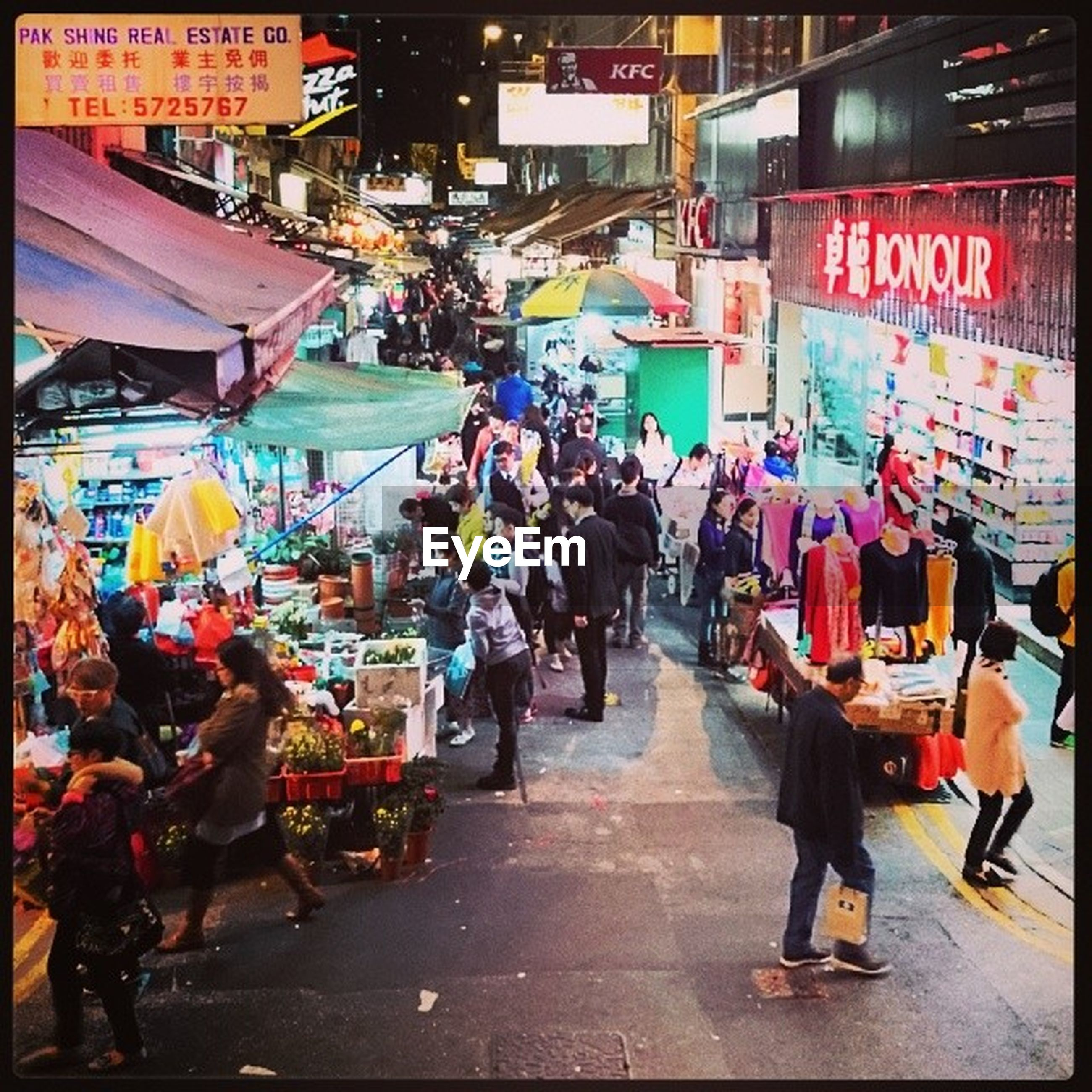 men, market, street, large group of people, person, market stall, lifestyles, walking, building exterior, retail, city, city life, architecture, store, built structure, street market, shopping, leisure activity, rear view