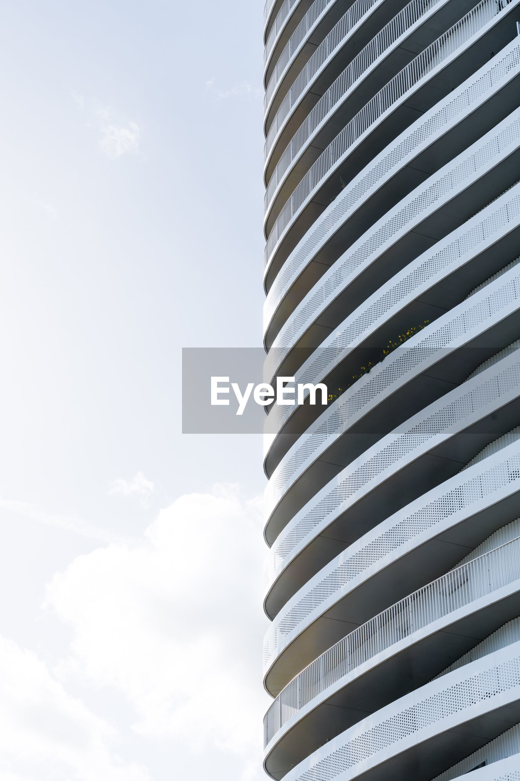 sky, architecture, building exterior, cloud - sky, built structure, low angle view, day, pattern, no people, nature, outdoors, building, office building exterior, modern, striped, sunlight, city, office, close-up, tall - high, skyscraper