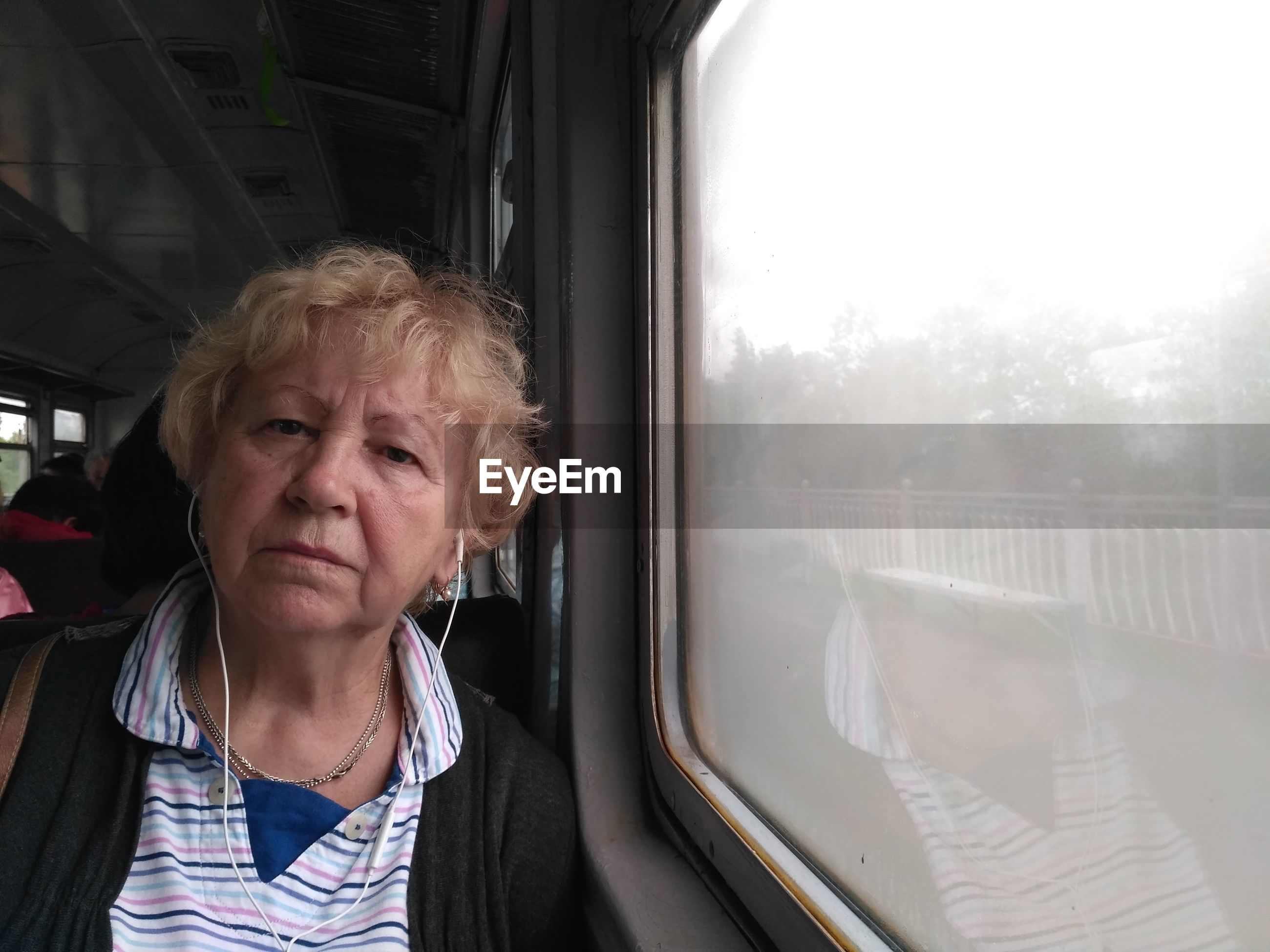 GIRL SITTING ON TRAIN WINDOW