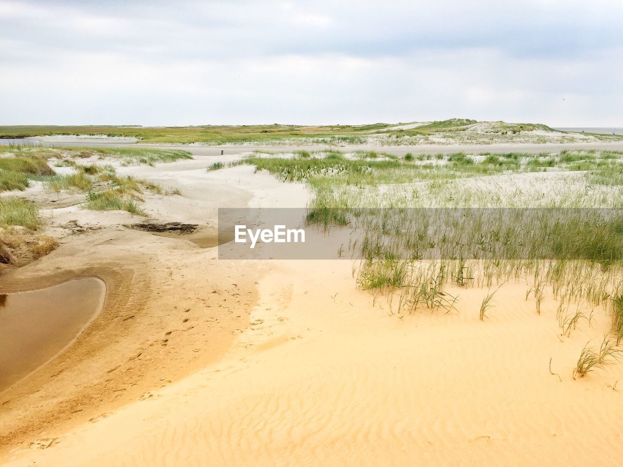 sand, nature, tranquility, tranquil scene, scenics, sky, beach, landscape, beauty in nature, day, no people, outdoors, sea, water, sand dune