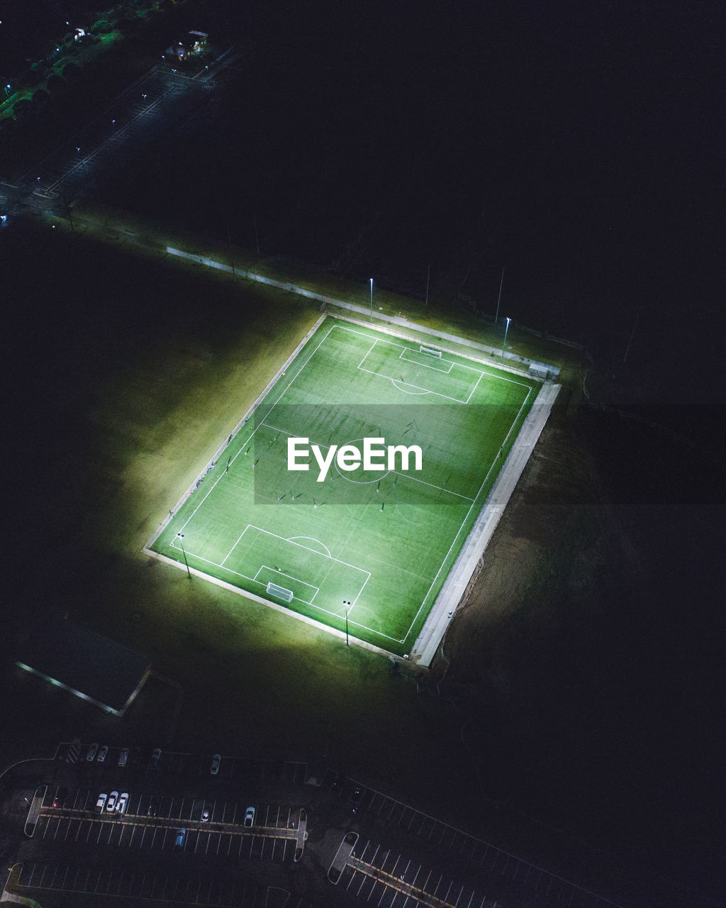 Aerial view of illuminated soccer field at night