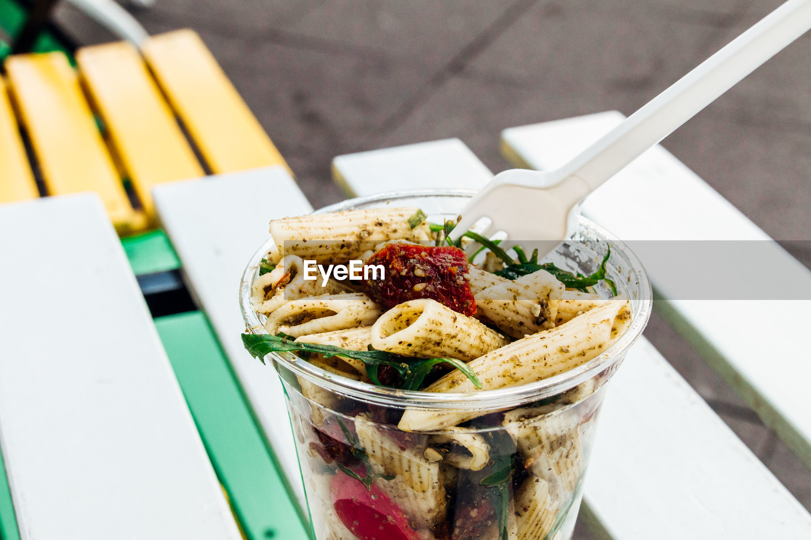 Close-up of pasta in disposable cup on table