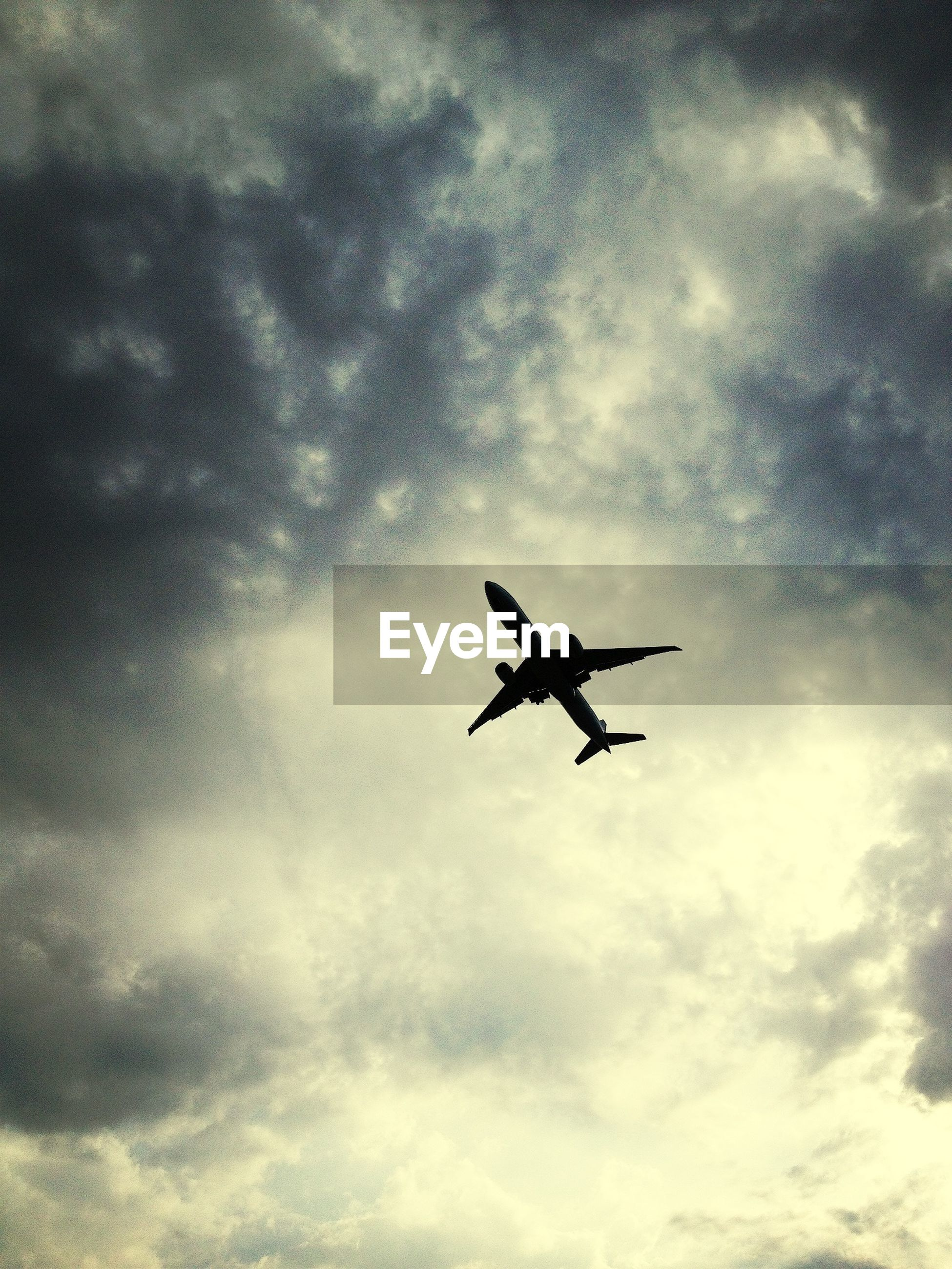 Silhouette of airplane in sky