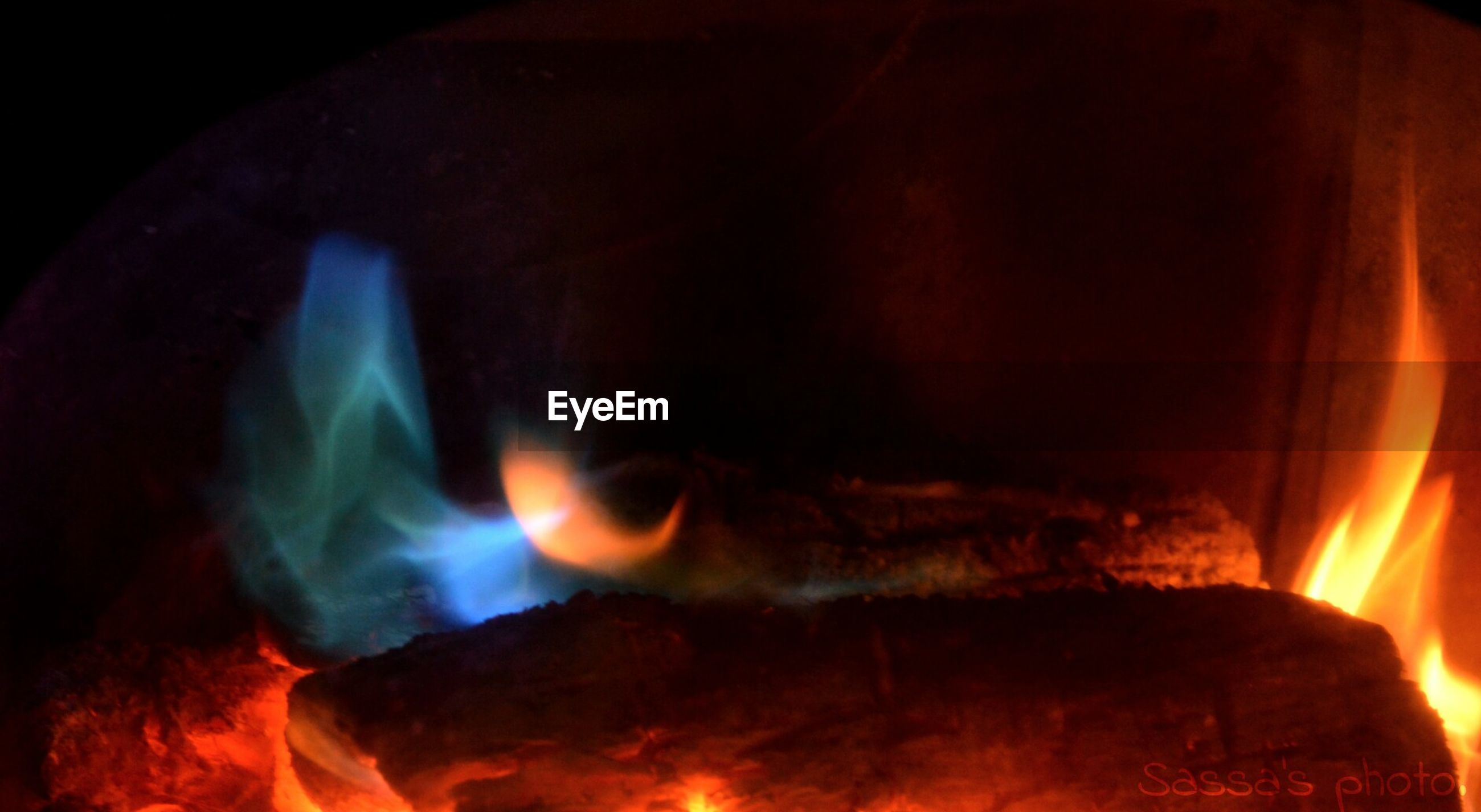 burning, flame, fire - natural phenomenon, heat - temperature, bonfire, glowing, fire, heat, close-up, campfire, orange color, night, indoors, firewood, motion, smoke - physical structure, light - natural phenomenon, no people, dark