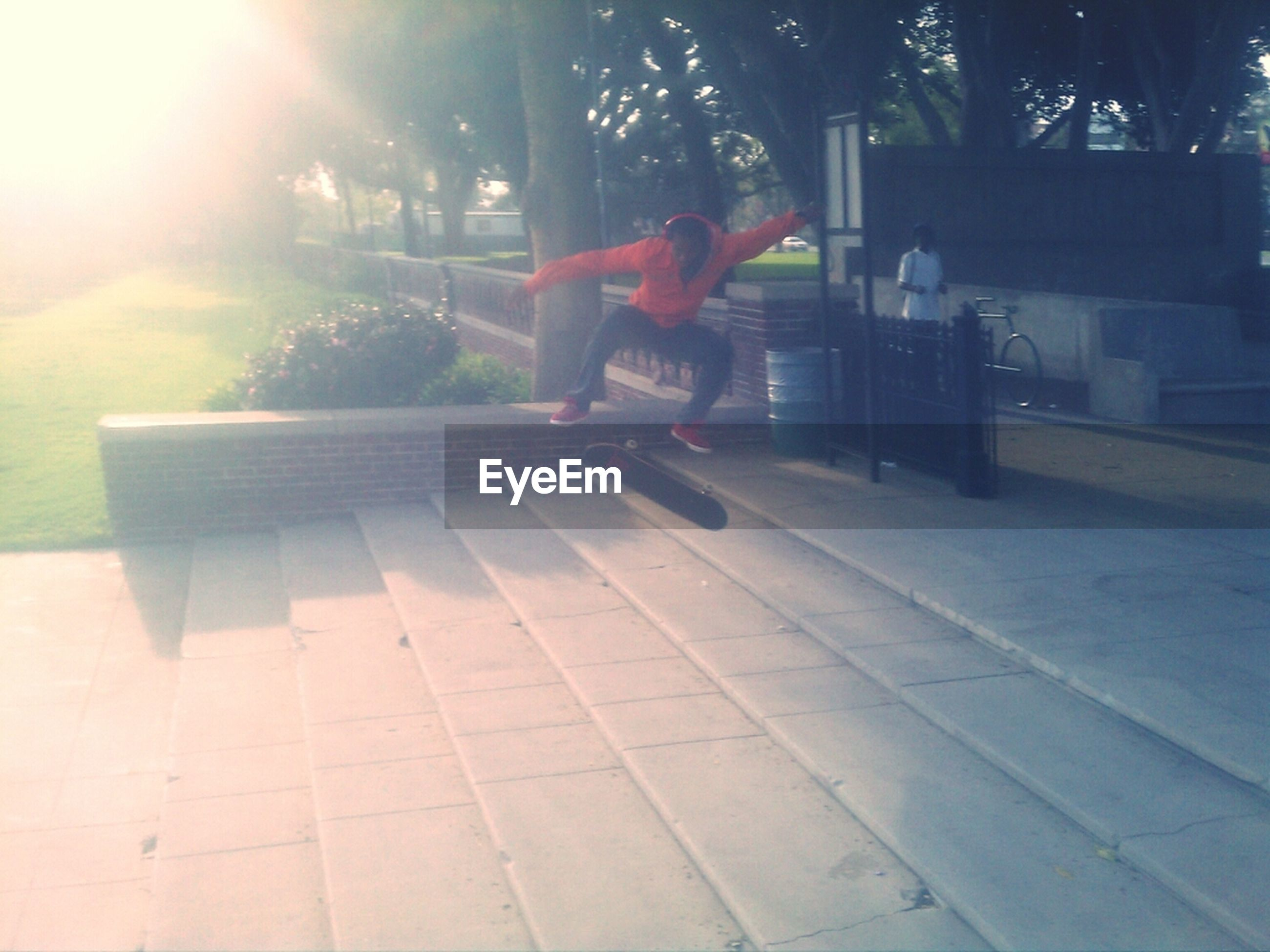sunlight, tree, sunbeam, full length, shadow, leisure activity, built structure, lifestyles, outdoors, day, lens flare, architecture, building exterior, sunny, park - man made space, chair, bench, sidewalk