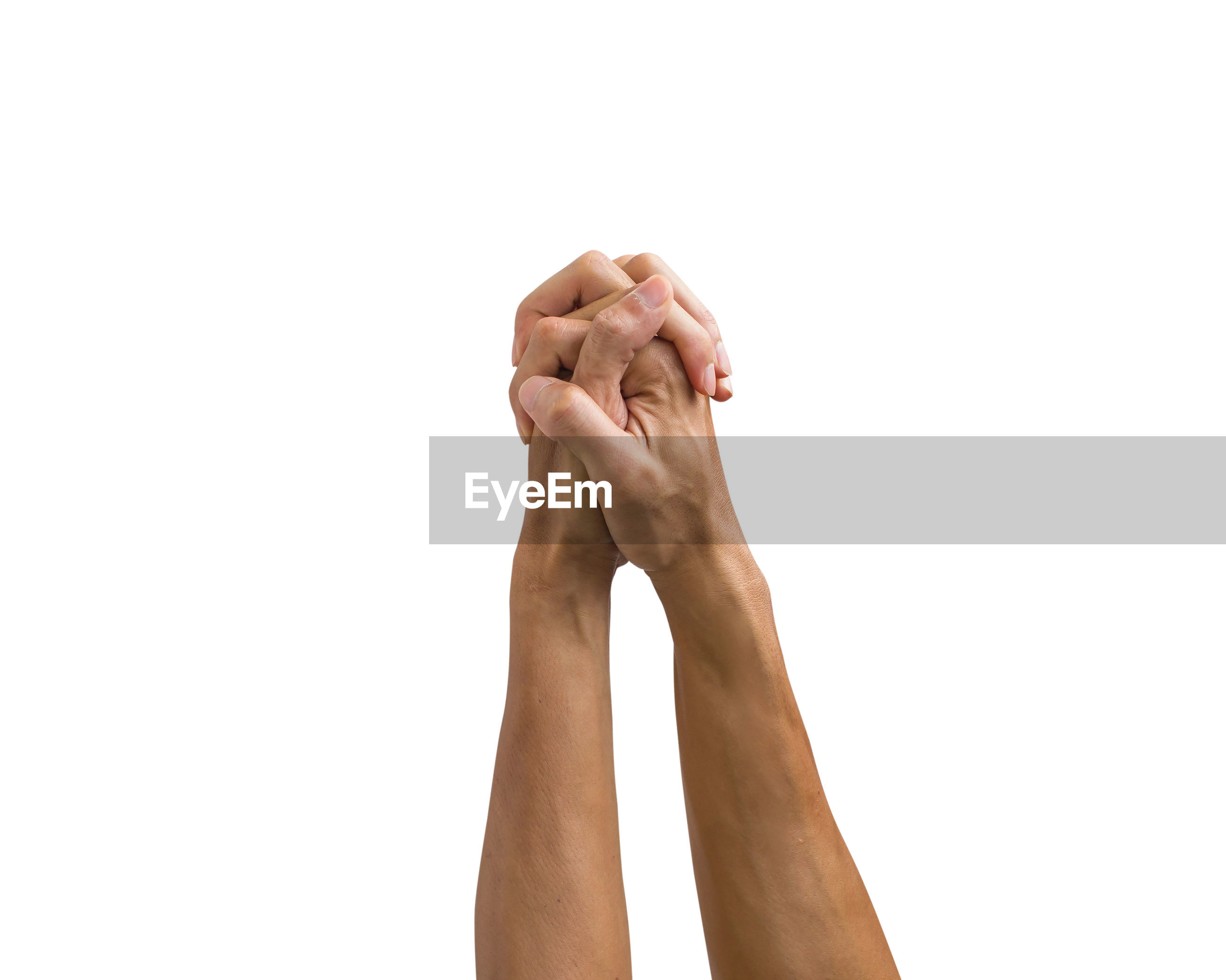 Cropped image of hands praying against white background