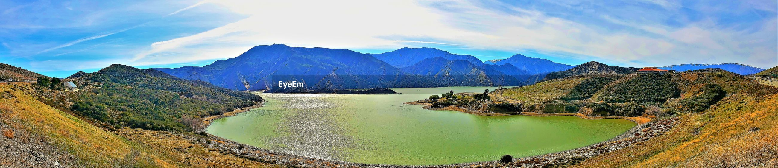 PANORAMIC VIEW OF LAKE AND MOUNTAIN AGAINST SKY