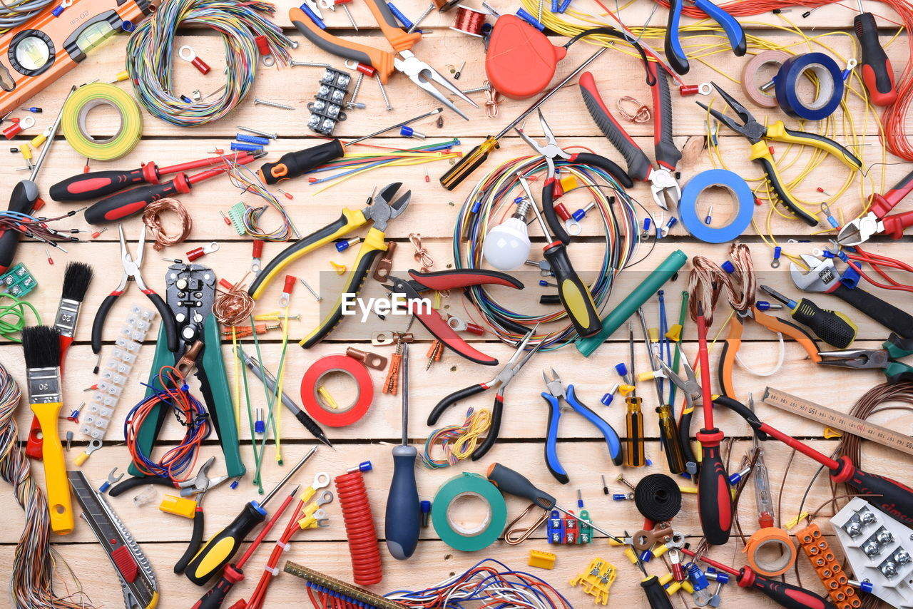 large group of objects, multi colored, variation, choice, indoors, full frame, abundance, no people, scissors, directly above, high angle view, collection, still life, cable, industry, backgrounds, art and craft, hand tool, tool, messy, complexity, chaos, streamer