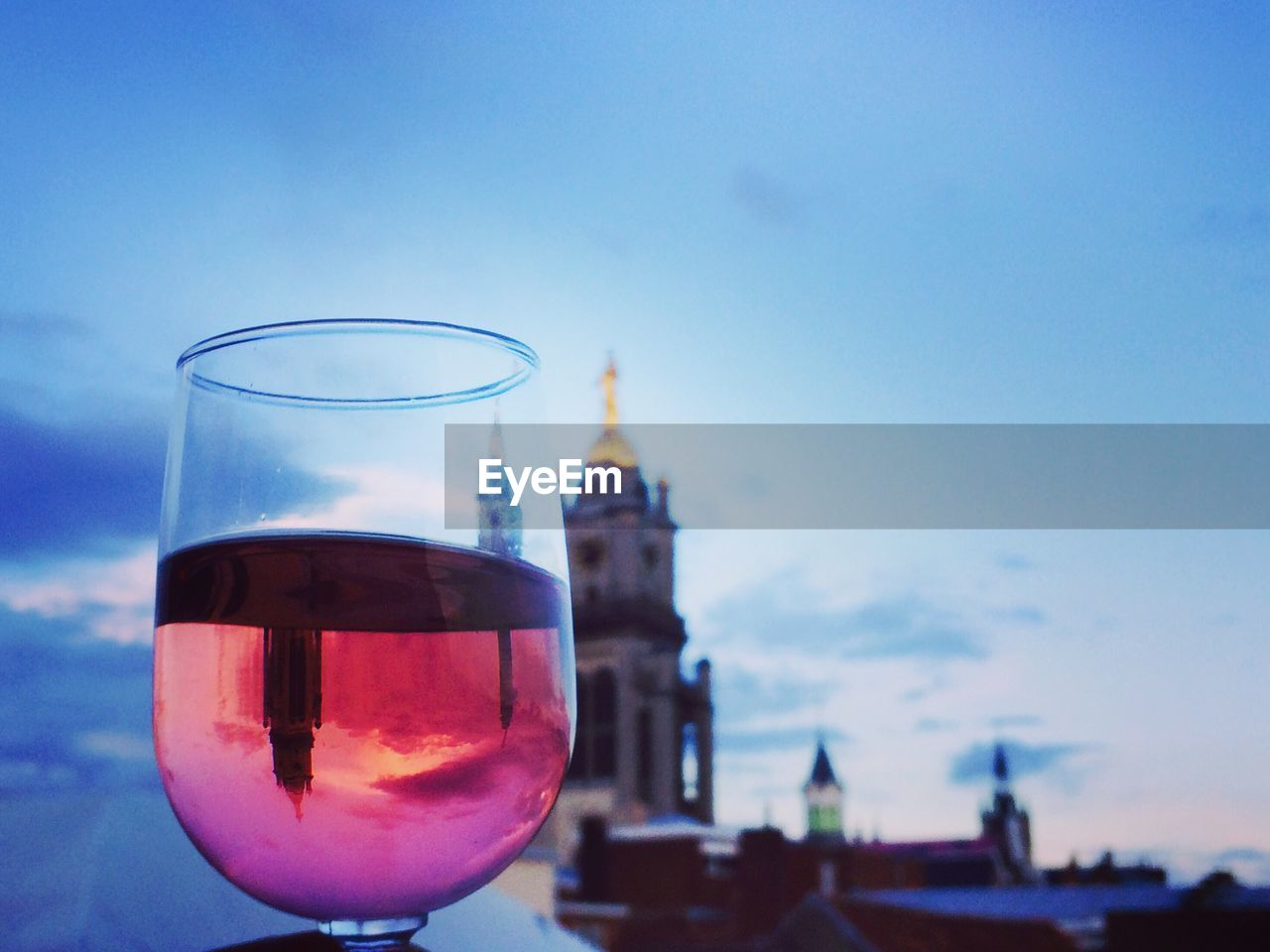 built structure, sky, architecture, building exterior, drink, glass, refreshment, focus on foreground, no people, building, nature, close-up, food and drink, transparent, alcohol, day, tower, glass - material, travel destinations, drinking glass