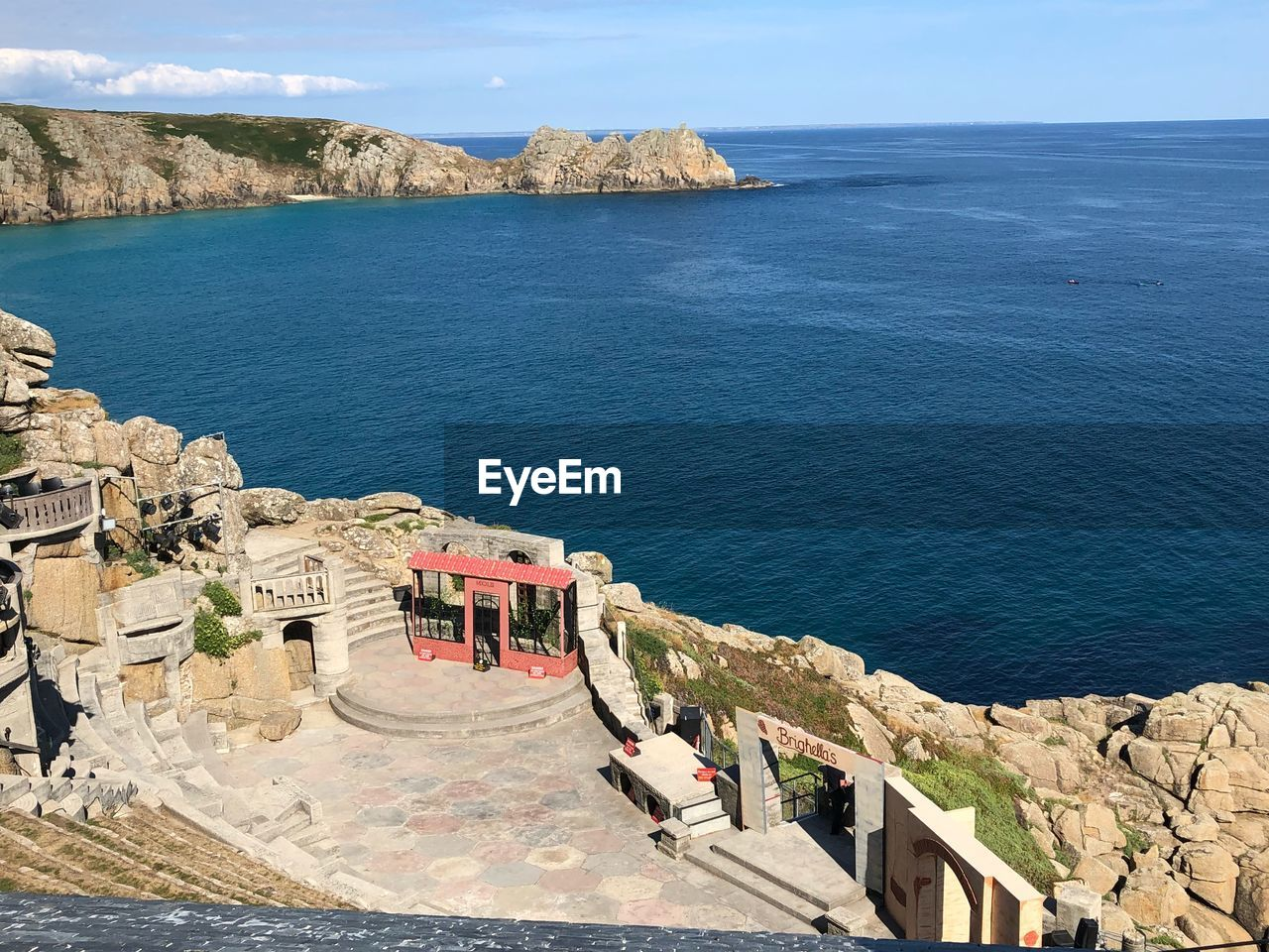 sea, water, architecture, built structure, sky, horizon over water, high angle view, day, nature, building exterior, horizon, scenics - nature, beauty in nature, cliff, sunlight, mountain, travel destinations, rock, history, outdoors