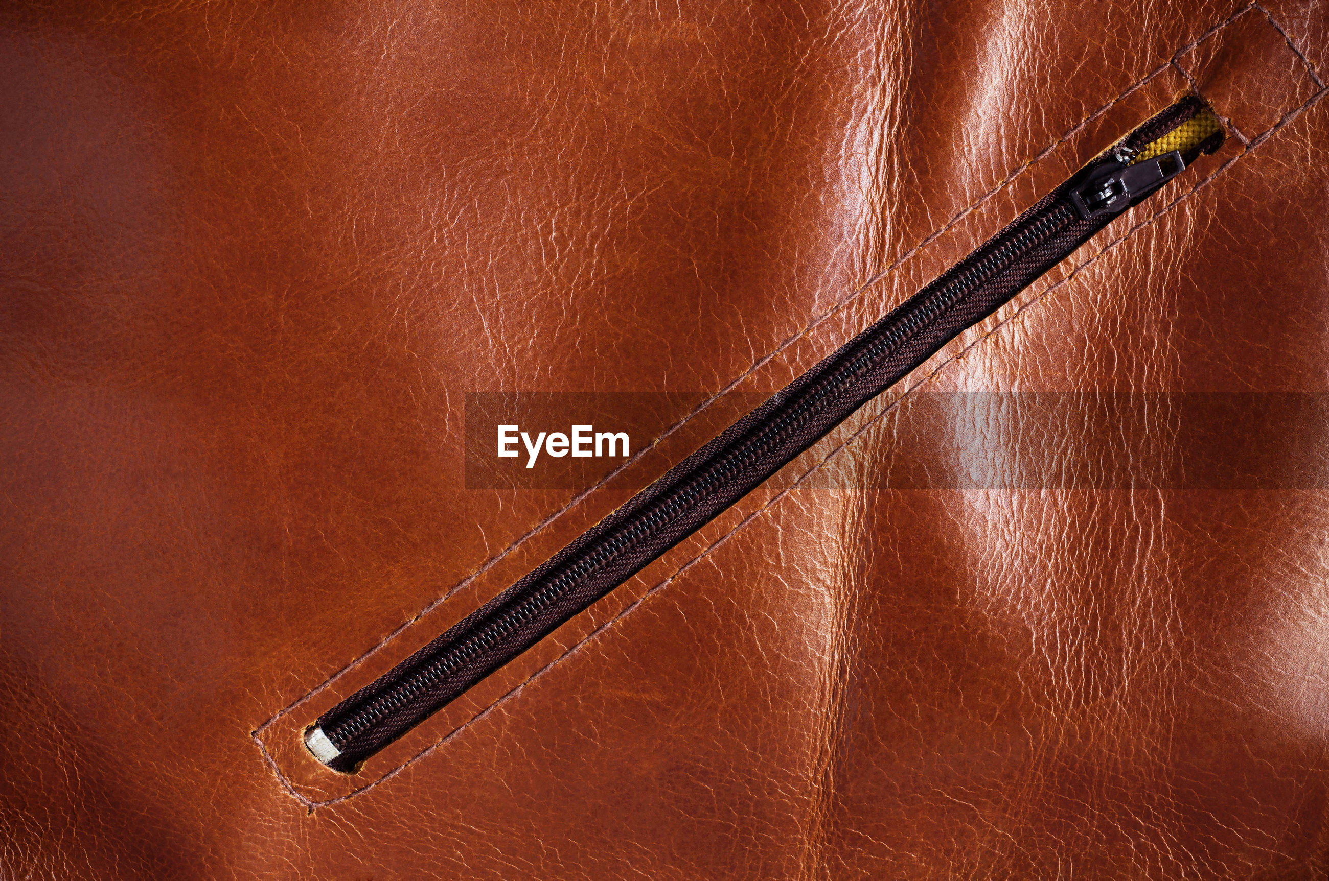 Full frame shot of brown leather with zipper